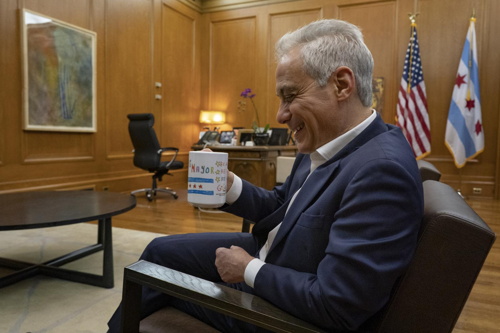 Former Chicago Mayor Rahm Emanuel drinks tea during an interview with the Washington Post's Lori Aratani in his office at City Hall in Chicago on April 24, 2019.