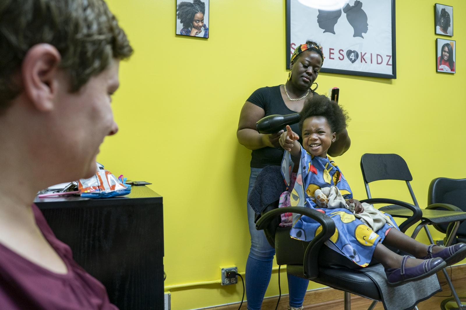 Daisy Feidt watches her daughter Ana Tow, 4, as she gets her hair braided by Shavonne Patterson at Styles 4 Kidz in Oak Park on May 25, 2019. Styles 4 Kidz provides hair care education and styling services for African American kids in transracial adoptive families and foster care.