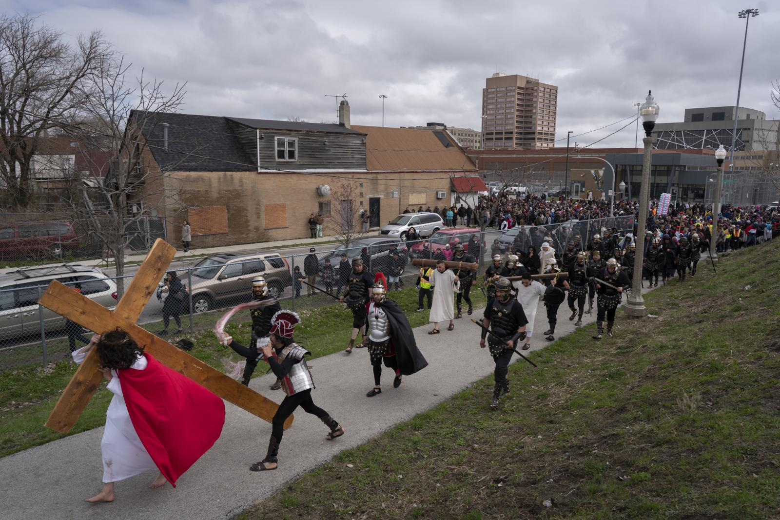 Via Crucis passes the Cook County Jail in Chicago on April 19, 2019.