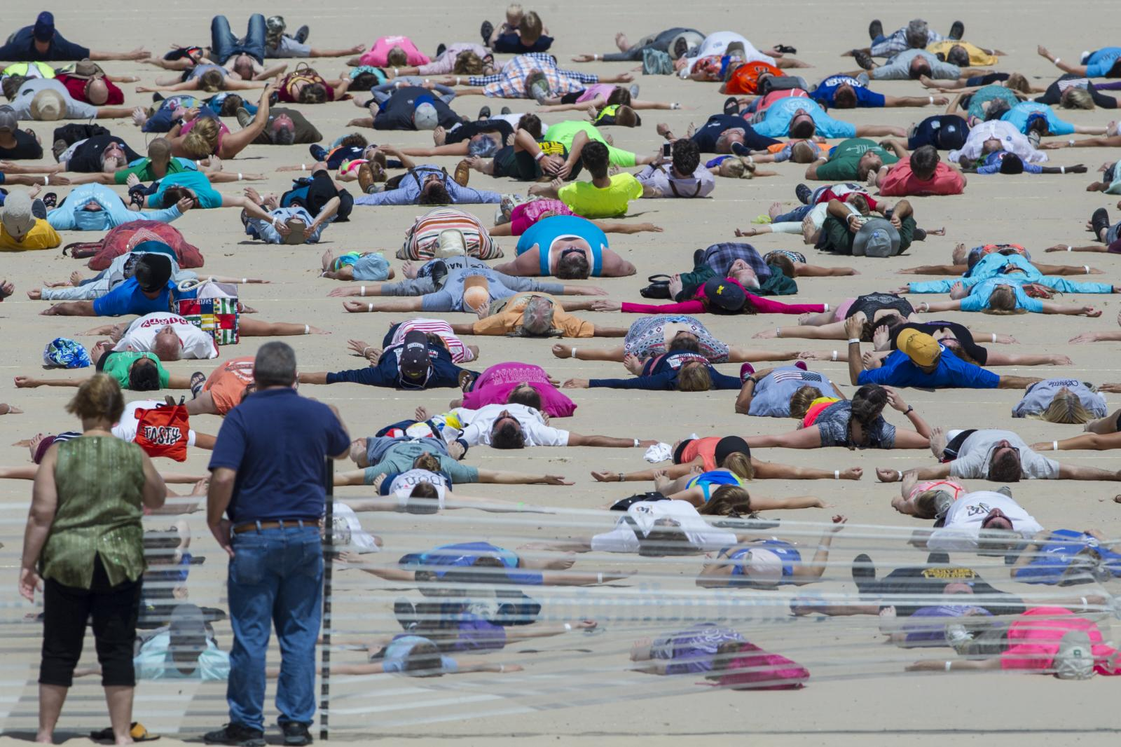 1,414 participate in the Guinness World Record attempt for simultaneously making sand angels at Stearns Park Beach on June 10, 2017 in Ludington, Mich. Ludington officially broke the record with 1,387 people, 27 people were disqualified for various reasons. The previous record was held by Pembrokeshire, United Kingdom, with 352 people simultaneously making sand angels on June 6, 2015.