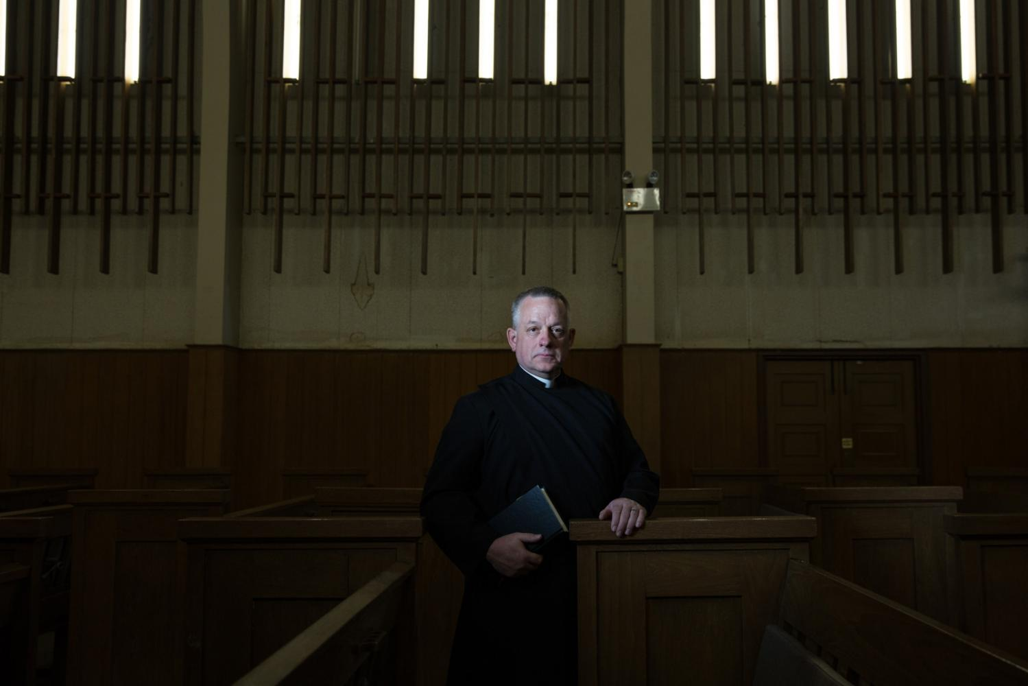 American Anglican Priest Erich Junger stands in a church in Bangkok, Thailand.
