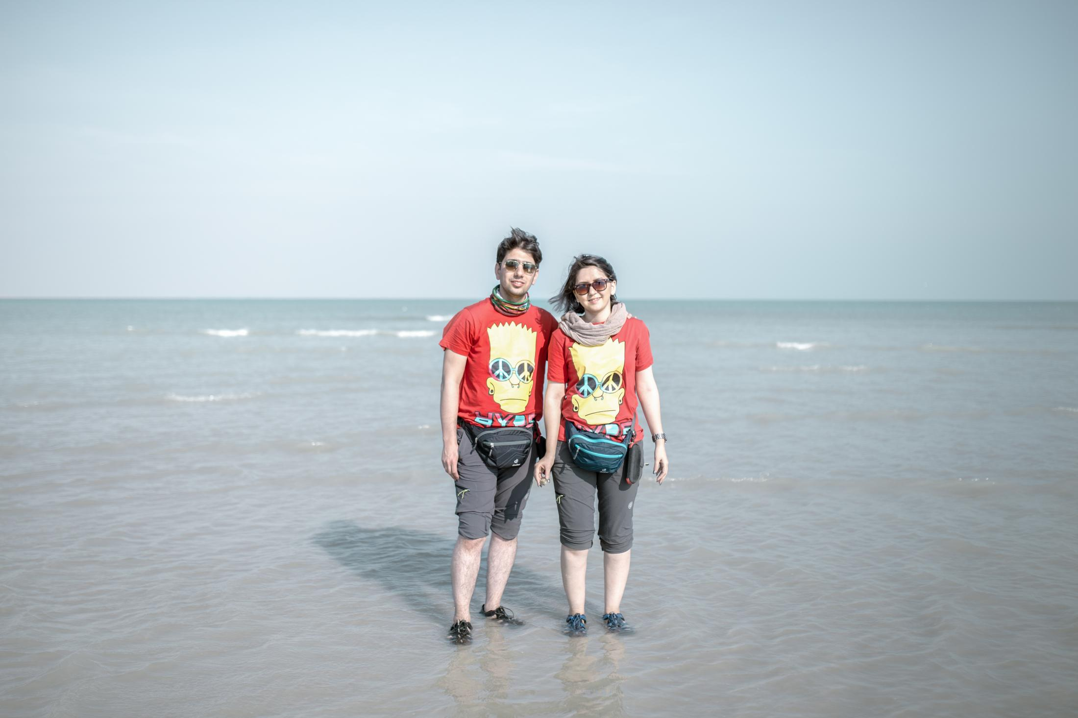 Iranian tourist couple takes leisurely walks down the Oman beach in the port of Beris which is located 60 km east of Chabahar area in Sistan and Baluchistan province. Regardless of the population of more than 5,000 people and being on the sea, people lack secure access to freshwater in the Beris port. They still use tankers for drinking water. Despite the scarcity of water sources, 2017 witnessed an increase in the number of tourists to Sistan and Baluchestan, which promised to bring in some solace for the tottering local economy in which 95% of people living under the poverty line. The main attractions were sectors that did not depend on water. However, it failed to effect a significant change. Balochistan province. Iran.2018