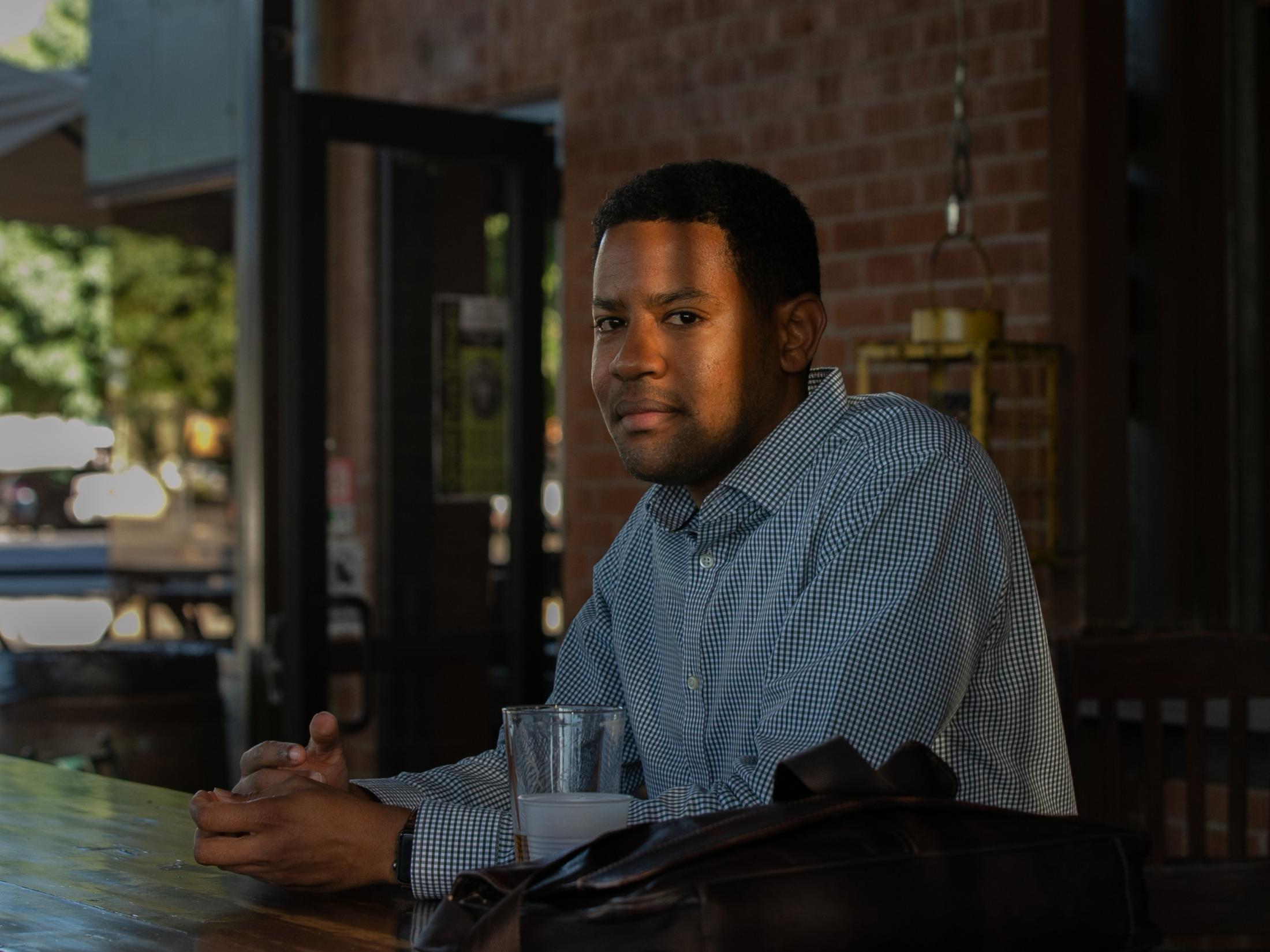 Downtown Phoenix resident Omar Peters enjoys a beer after work at The Grand Cafe in Phoenix.