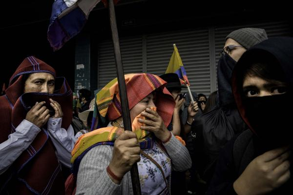 Demonstrators  moving away from tear pumps during a protest in the Historic Center of Quito, Ecuador, on Thursday, Oct. 3, 2019. Key highways are paralyzed across Ecuador after a night of clashes triggered by fuel price hikes, as a state of emergency enters its second day. Photographer: Johis Alarcon/Bloomberg