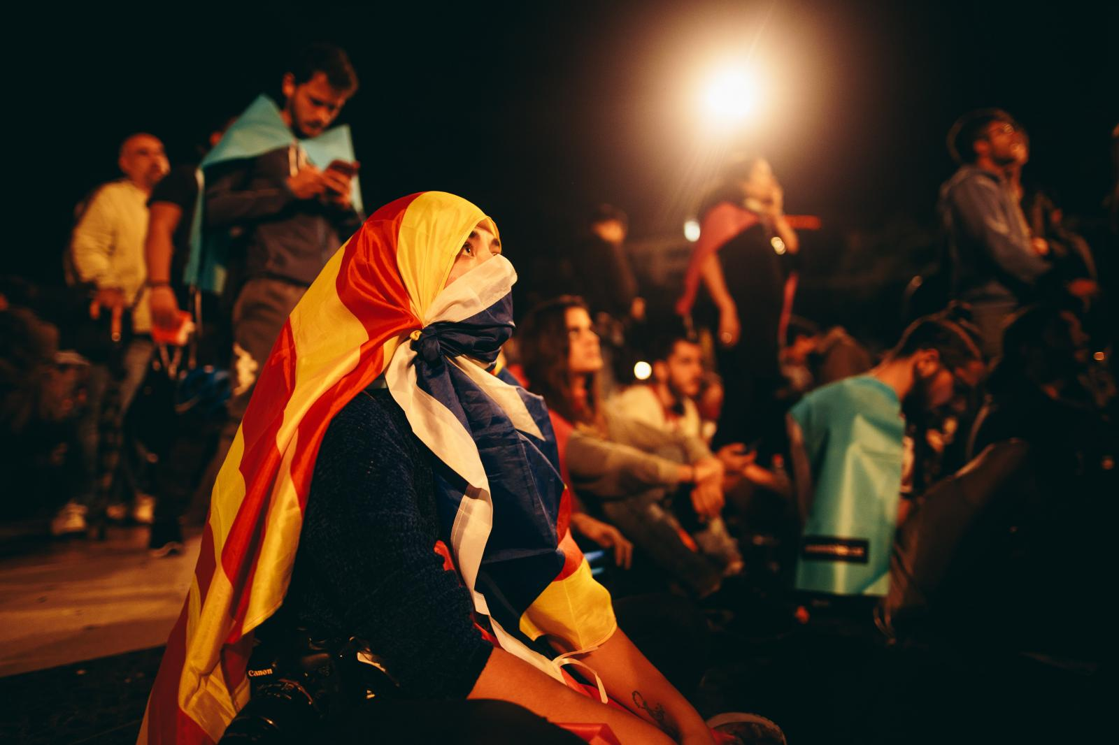A woman with a Catalan flag around her head awaits the results. October 1st, 2017