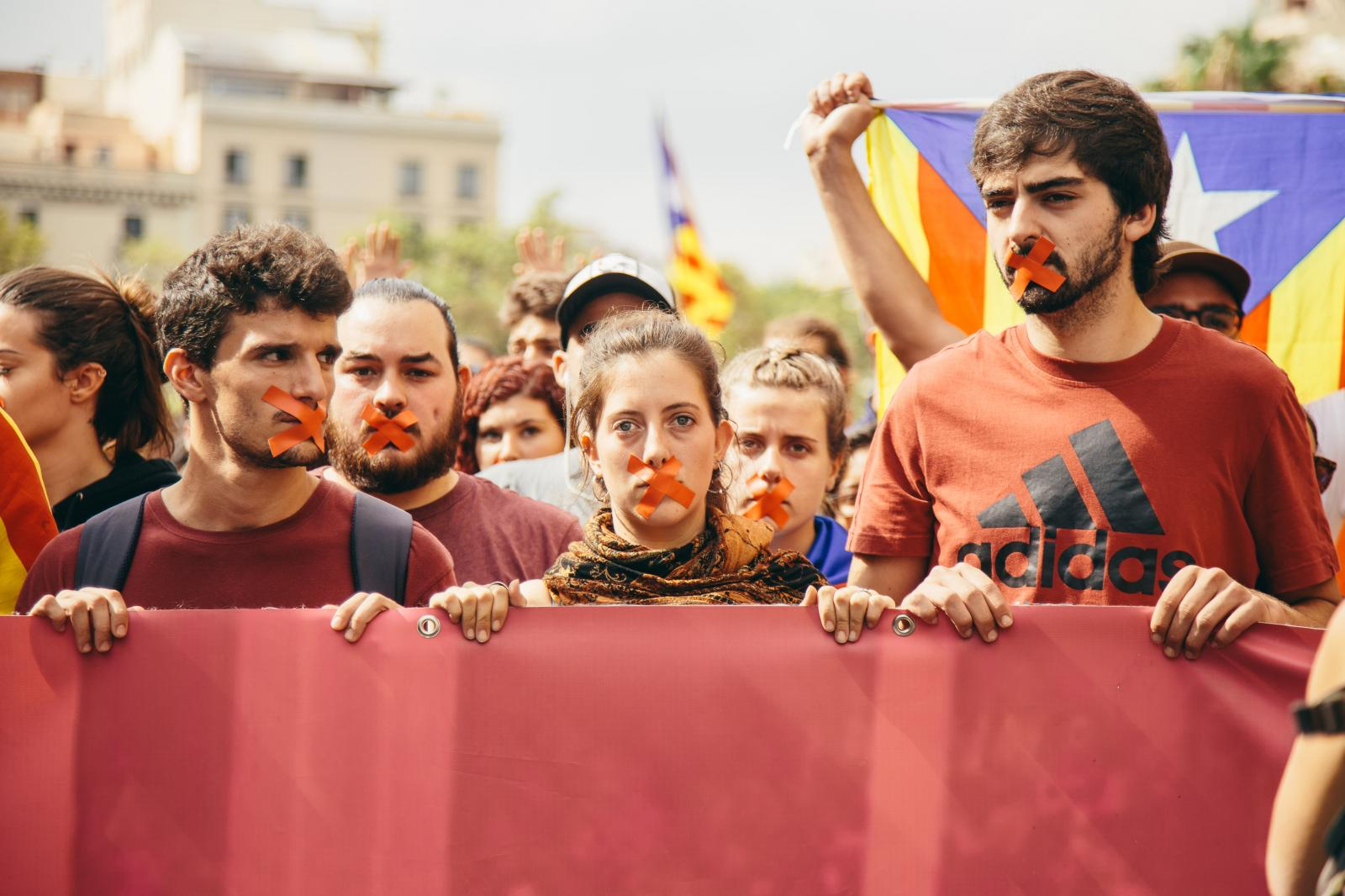 Students hold a march in central Barcelona with taped mouthes, feeling unheard by the reactions of the Spanish central government and urging a declaration of independence. October 2nd, 2017