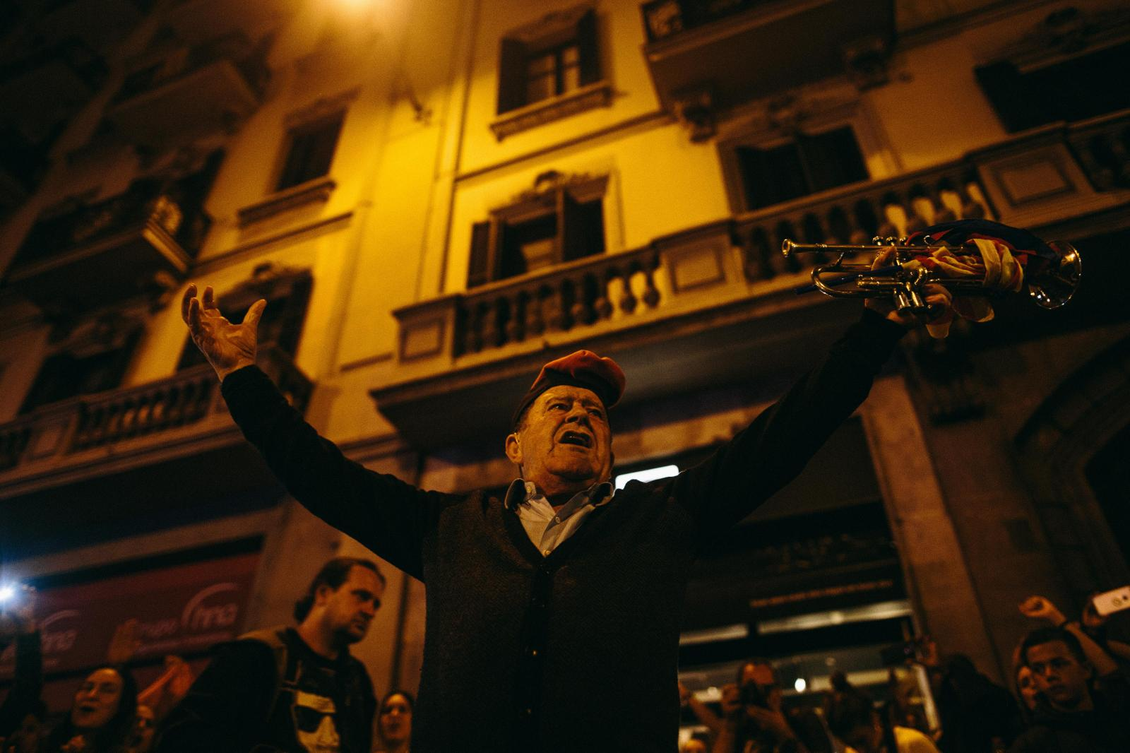 A man with a trumpet reacts to the crowd as he is about to play Catalan Independence songs. October 2nd, 2017