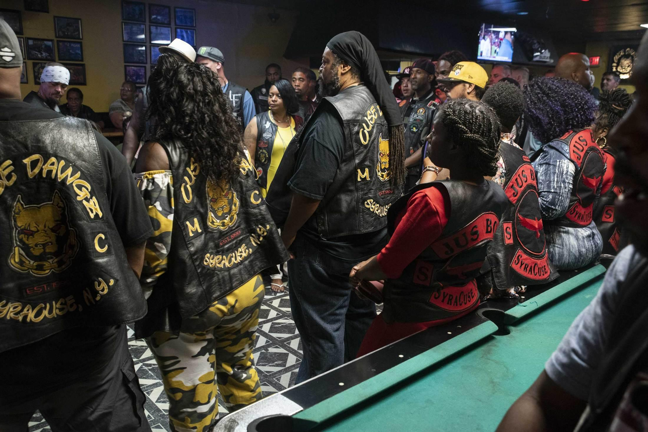 The Cuse Dawgz Motorcycle Club gathers with friends and family to celebrate their 19th anniversary.