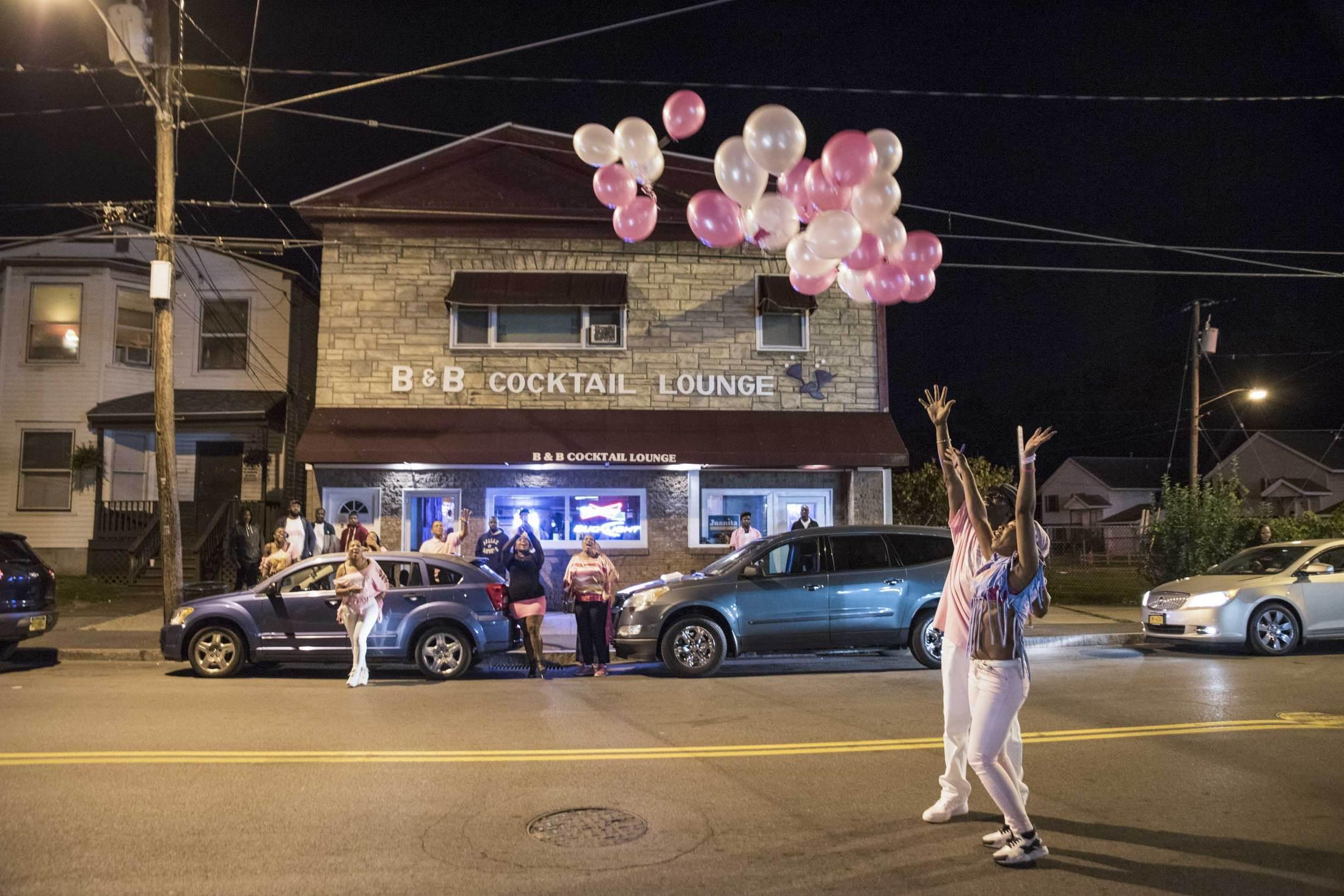 India Jenkins, a cancer survivor, releases balloons for a breast cancer awareness event at the B&B Cocktail Lounge on the South Side.