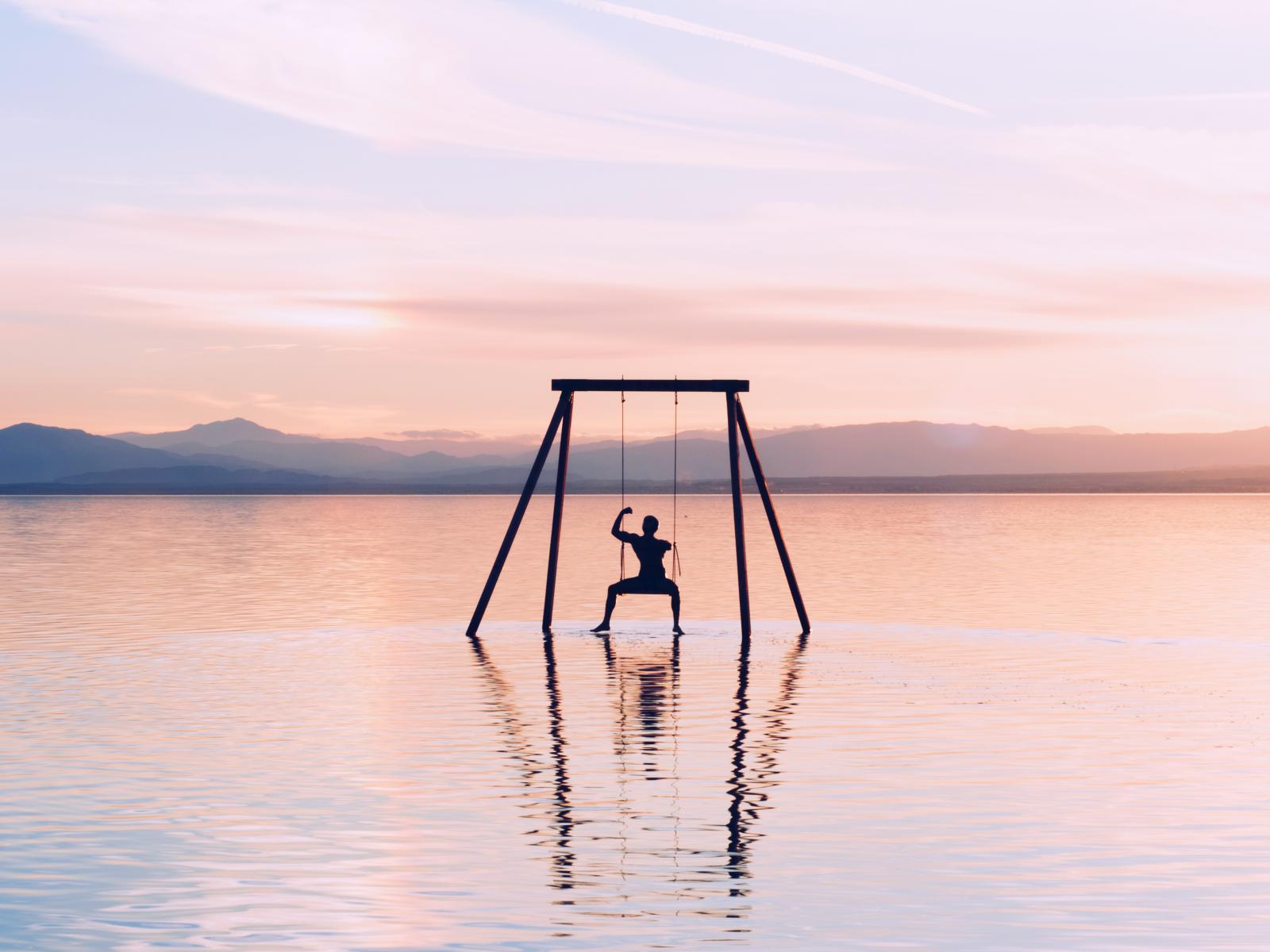 Photography image - Loading 8.-Attendee-on-swing-on-Salton-Sea.jpg