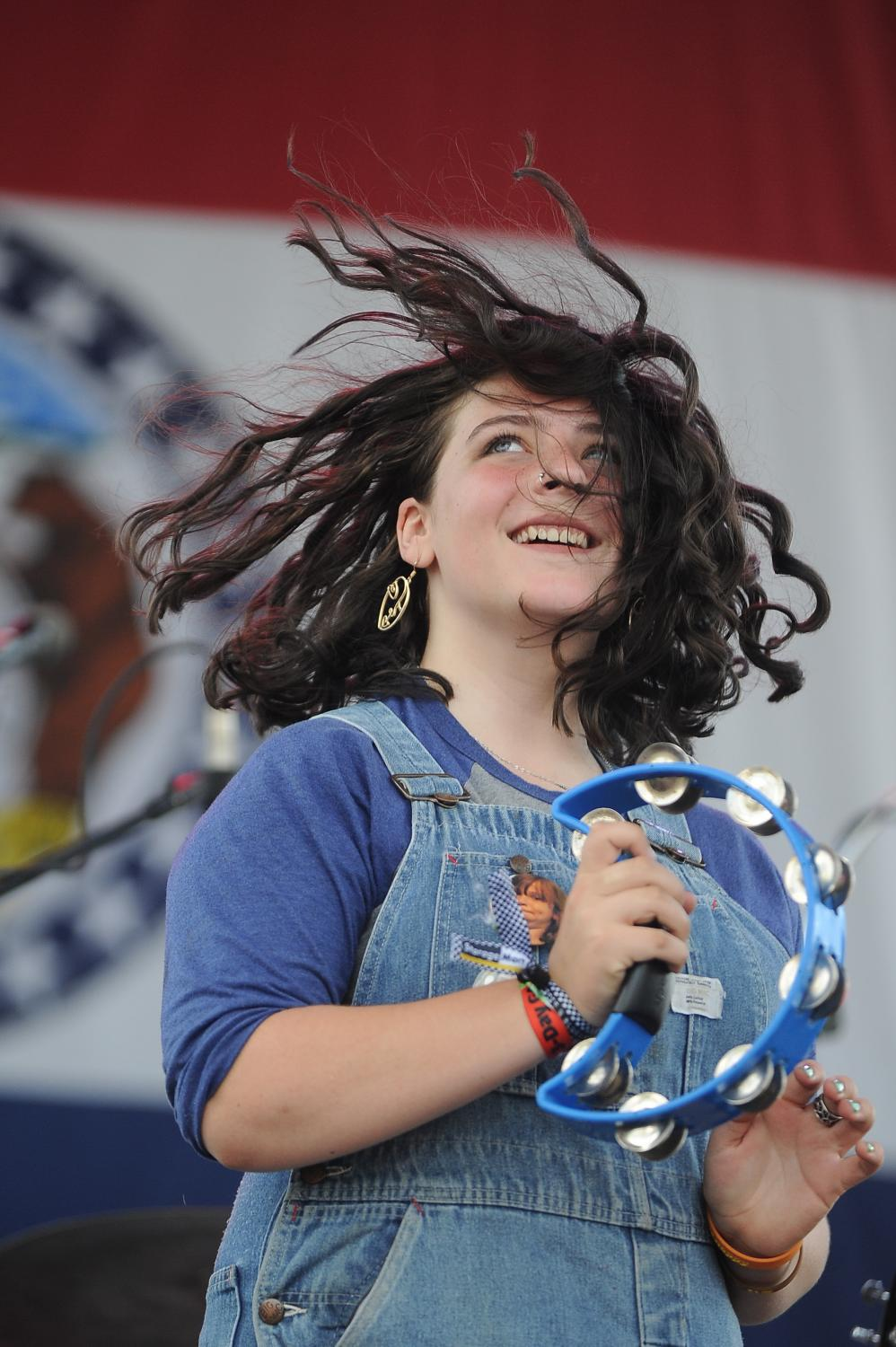 Olivia Burney plays tambourine with The Kay Brothers on Sept. 29, 2019 at the Roots N Blues N BBQ Festival at Stephens Lake Park in Columbia, Missouri. Burney is also a member of the Burney Sisters, a Columbia band that performed earlier in the afternoon
