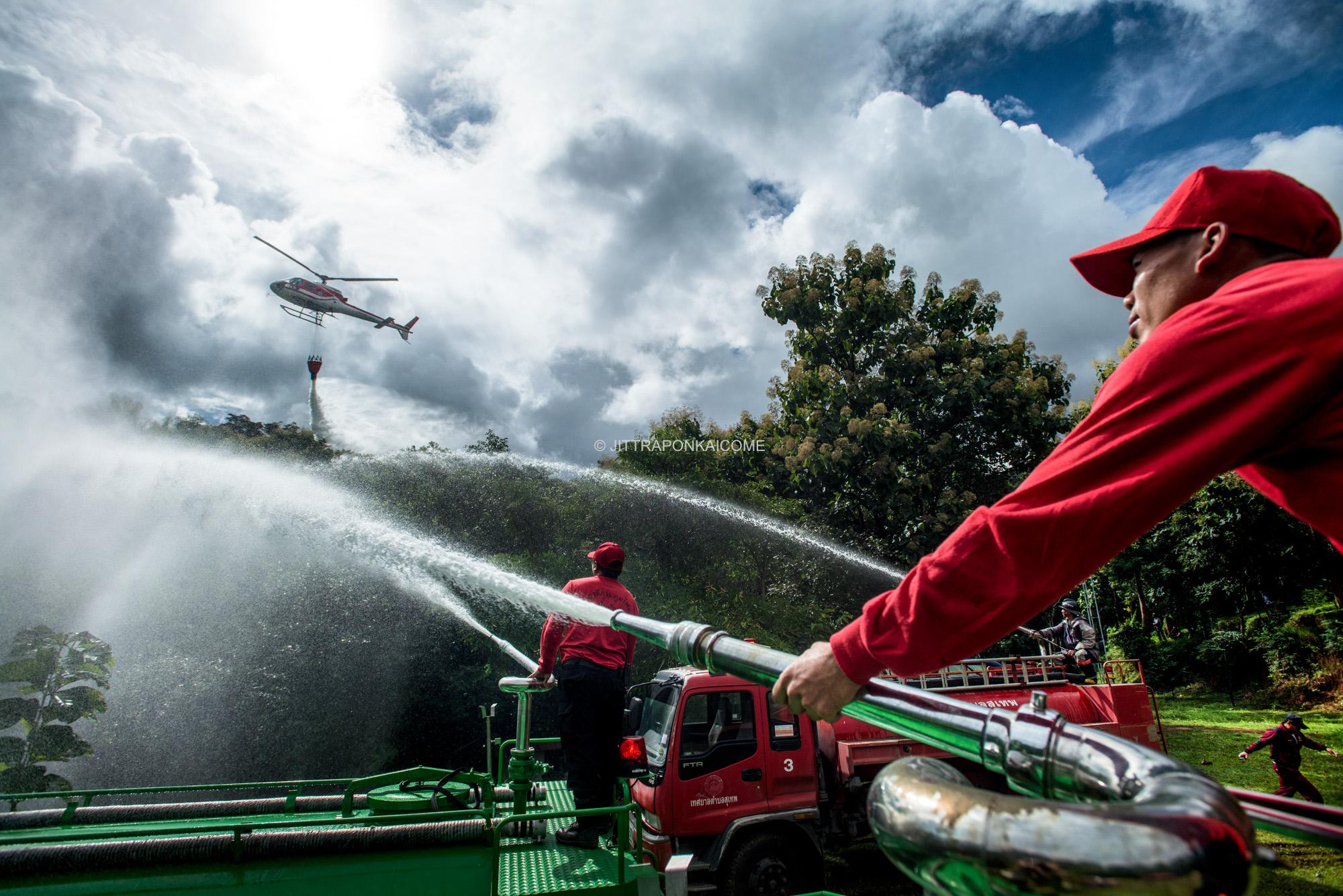 Firefighters demonstrate the capability of handling a wildfire. Chiang Mai, Thailand.