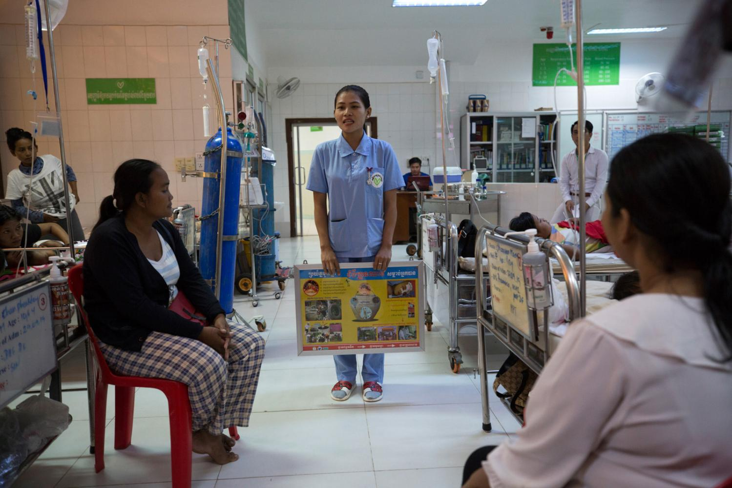 Due to the influx of dengue fever patients this year the nurses regularly give talks to patients on how to mitigate the problem of dengue fever and what causes it in the inpatient ward of the Angkor Hospital for Children. Siem Reap, Cambodia - October 2019