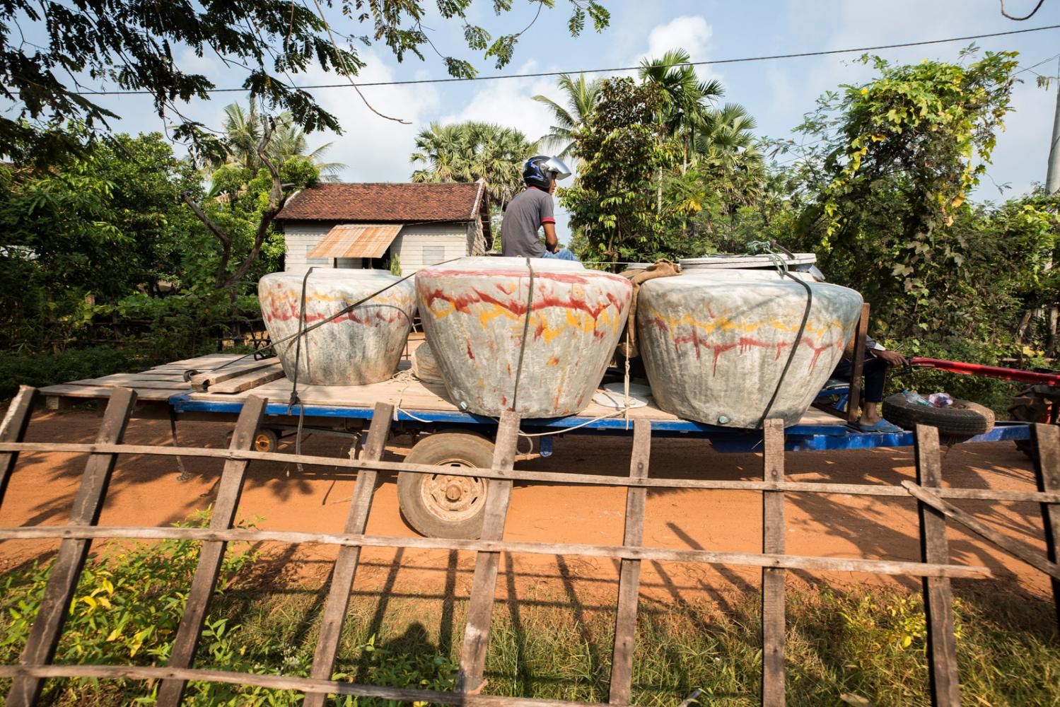 Large water jars used by villagers, schools and temples to collect rain water and used for cooking and drinking in rural Cambodia being transported. They are also the main culprit for breeding mosquitos and are believed to be one of the main causes for recent dengue fever outbreaks in Cambodia which has seen record numbers. Siem Reap Province, Cambodia - October 2019