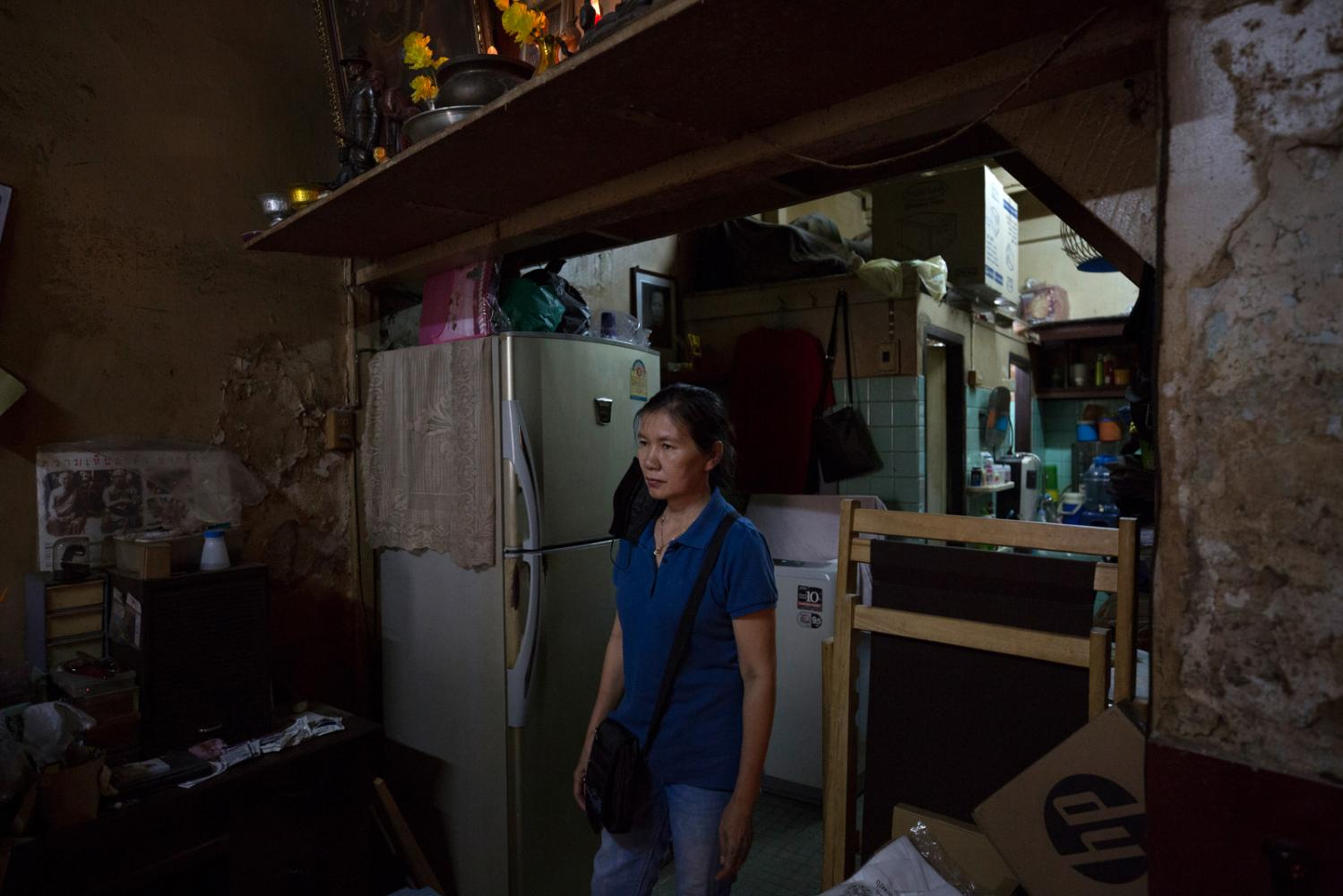 Sangjun Thimachai, 55, stands in her house which saw a dengue fever outbreak in September 2019 with 4 of her family members, including herself, getting the disease. Her husband Yotsathon Wongjiragorn, 58, also contracted the disease and after several misdiagnosis's died in hospital. Bangkok, Thailand - October 2019