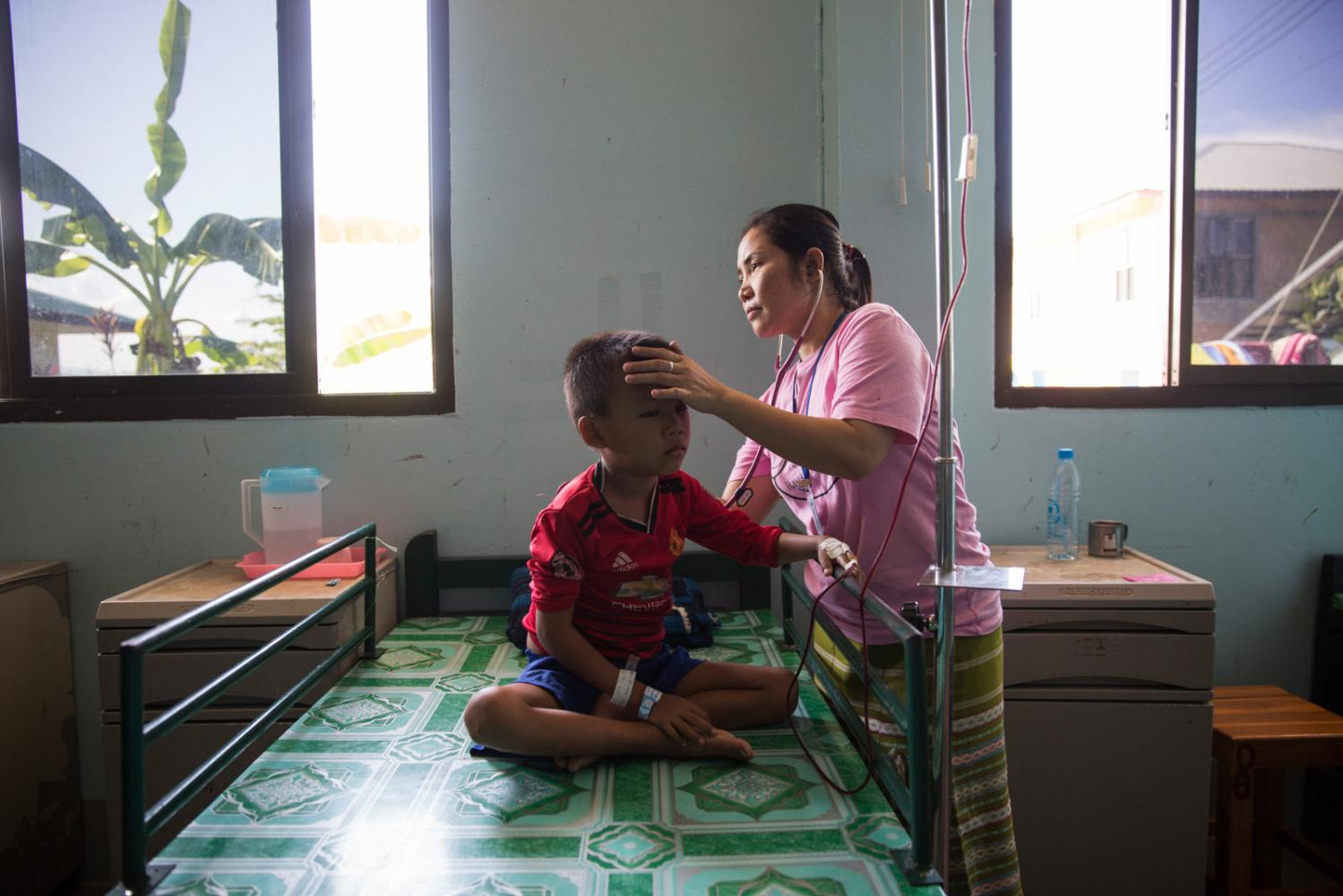 Tin Tin Soe, Clinical supervisor at the child-in patient department of Mae Tao Clinic treats a patient. In June 2019 after the outbreak of another mosquito borne disease called Chikunguniya in Mae Sot she became sick. Months later and her body still aches from the side-effects of the disease that whilst isn't life-threatening like dengue fever, it causes la huge burden on the sick. Mae Sot, Thailand - October 2019