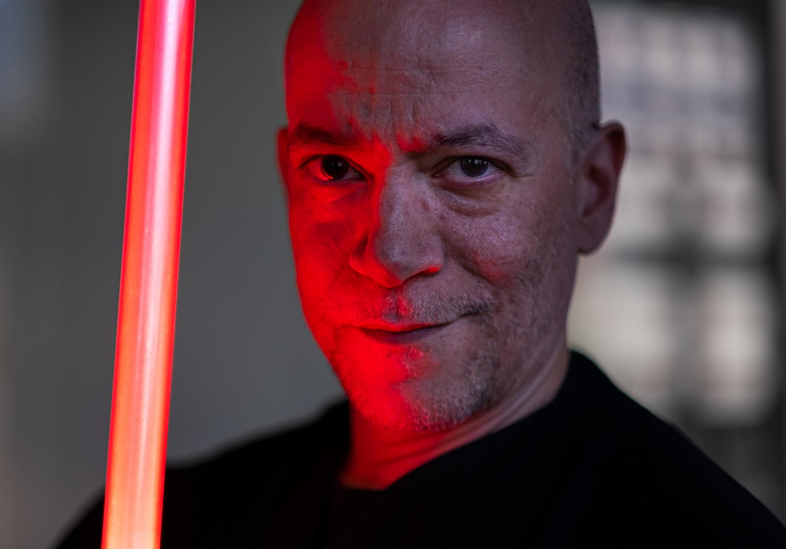 Portrait taken in Syracuse, New York, of light saber professional.