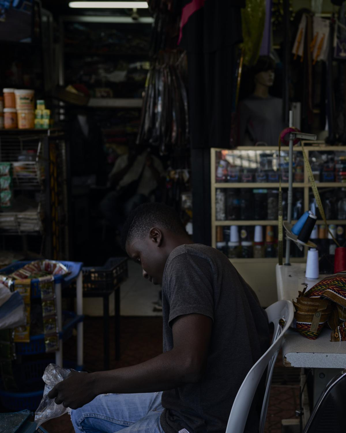 """Alamby, 16yr., explains in an interview: """"My situation is not easy, to have left Guinea so far today, as a child from a low-income family. I did not know the situation in Morocco before coming here. For me, this has been another life. To cross the sea and reach Europe, they ask for a large sum of money, which goes beyond my means. Given my current situation, I think I can get on all by myself. I need two or three years. At the moment, I do not have a good job"""". Casablanca, Morocco, 2019."""