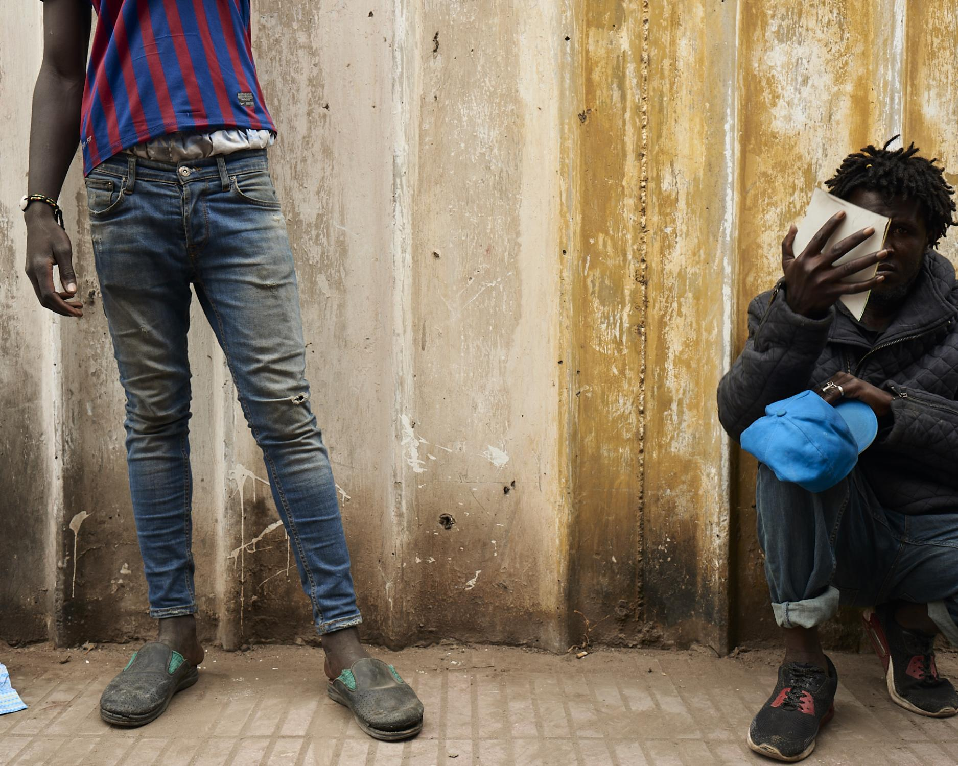 Underage boys, mostly from de Guinea, Ghana, Niger, or Ivory Coast, lives grouped as the only protection against criminal groups or even the police, that comes in raids and sends them back to farther border points within the country. Casablanca, Morocco, 2019.