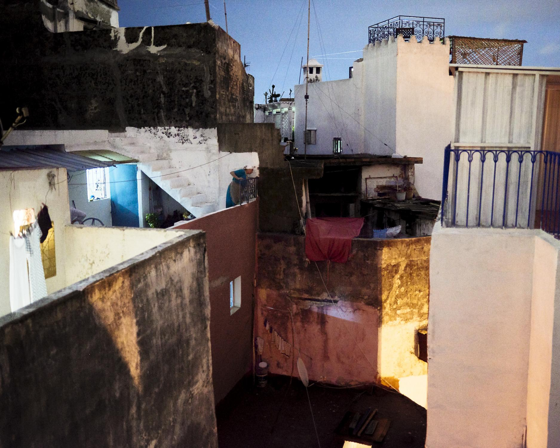 On the winding streets of the medina, many abandoned apartments are often 'squatted' by illegal immigrants, mostly coming from sub-Saharian countries. The majority already lived on improvised camps at the forest nearby Park Rmilat, in Tangier. Tangier, Morocco. 2019.