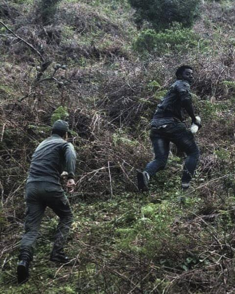 A Ghanaian man runs uphill from the Moroccan police in a raid at the forest of Rmilat, in Tangier. This picture belongs to Mohamed's archive, who at the time of sharing it for this reportage, he was saving money for an upcoming trip before the summer ends. Tangier, Morocco. 2019.