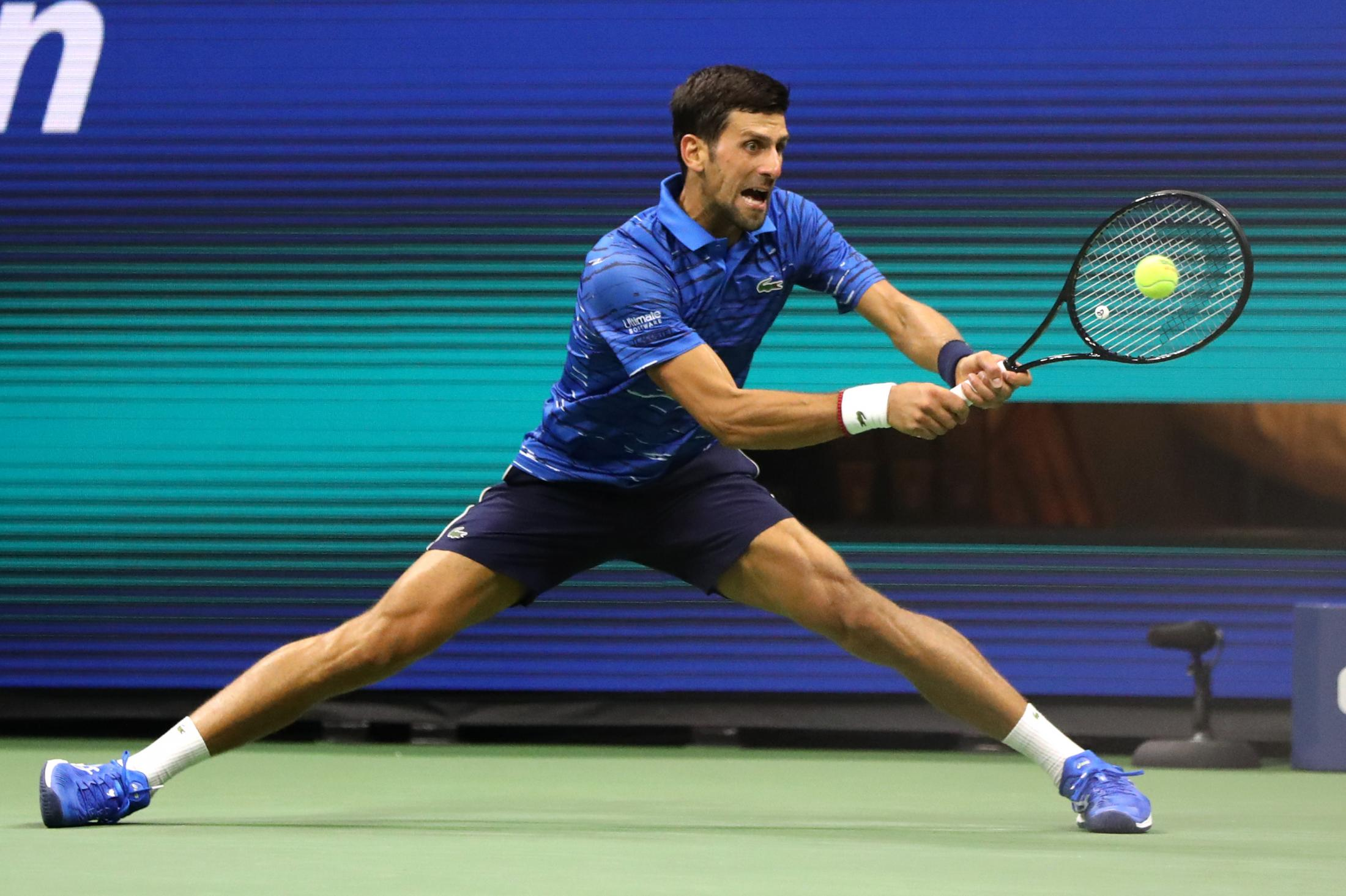 NEW YORK, NEW YORK - AUGUST 28: Novak Djokovic of Serbia returns a shot during his Men's Singles second round match against Juan Ignacio Londero of Argentina on day three of the 2019 US Open at the USTA Billie Jean King National Tennis Center on August 28, 2019 in the Flushing neighborhood of the Queens borough of New York City. (Photo by Katharine Lotze/Getty Images)