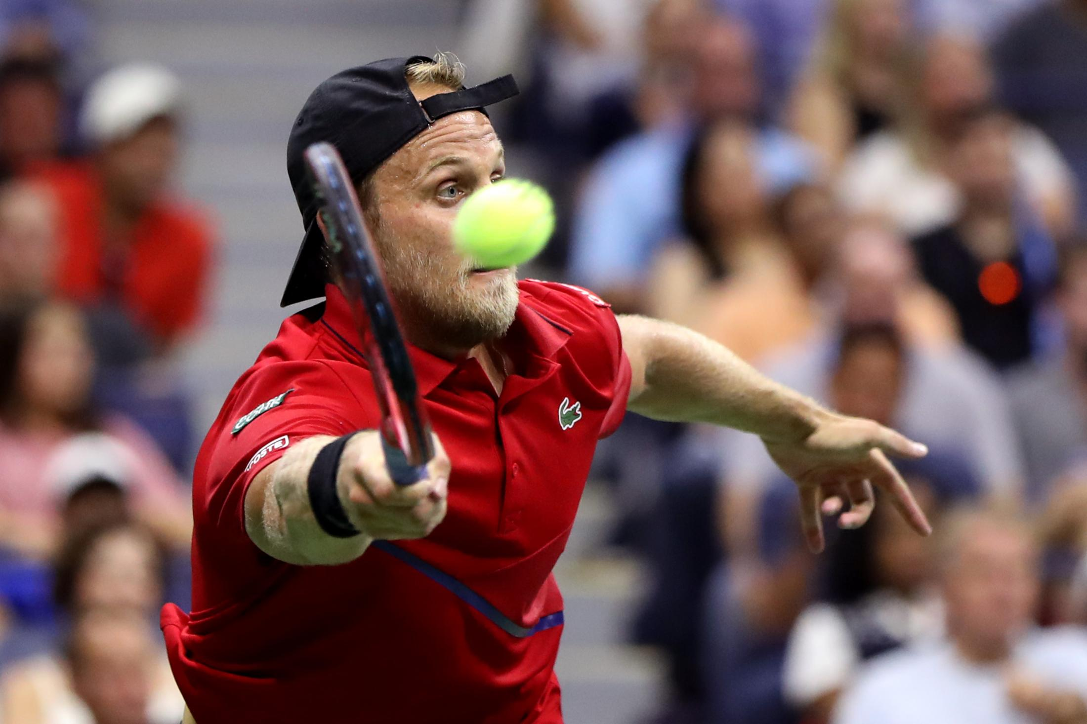 NEW YORK, NEW YORK - AUGUST 30: Denis Kudla of the United States returns a shot during his Men's Singles third round match against Novak Djokovic of Serbia on day five of the 2019 US Open at the USTA Billie Jean King National Tennis Center on August 30, 2019 in Queens borough of New York City. (Photo by Katharine Lotze/Getty Images)