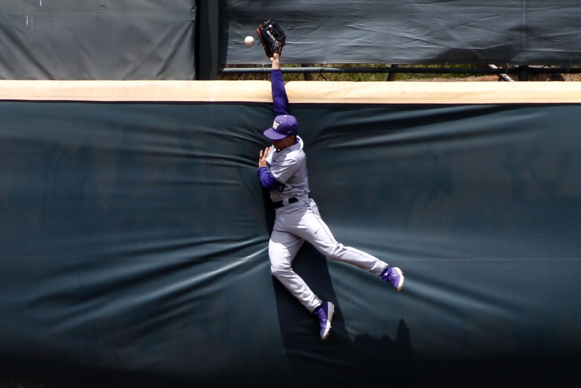 LOS ANGELES, CALIFORNIA - MAY 19:  Mason Cerrillo #6 of University of Washington jumps to try to catch the ball during a baseball game UCLA at Jackie Robinson Stadium on May 19, 2019 in Los Angeles, California. (Photo by Katharine Lotze/Getty Images)