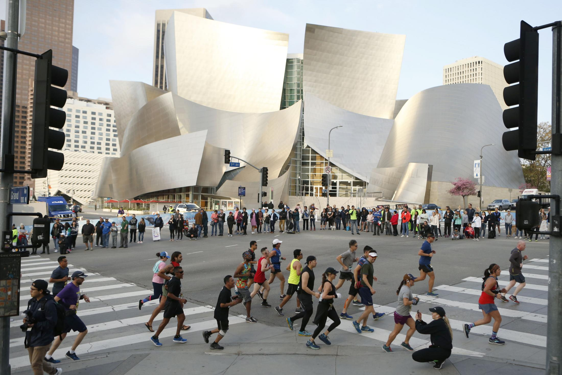 LOS ANGELES, CALIFORNIA - MARCH 24:   Runners run by the Walt Disney Concert Hall during the 2019 Skechers Performance Los Angeles Marathon on March 24, 2019 in Los Angeles, California. (Photo by Katharine Lotze/Getty Images)