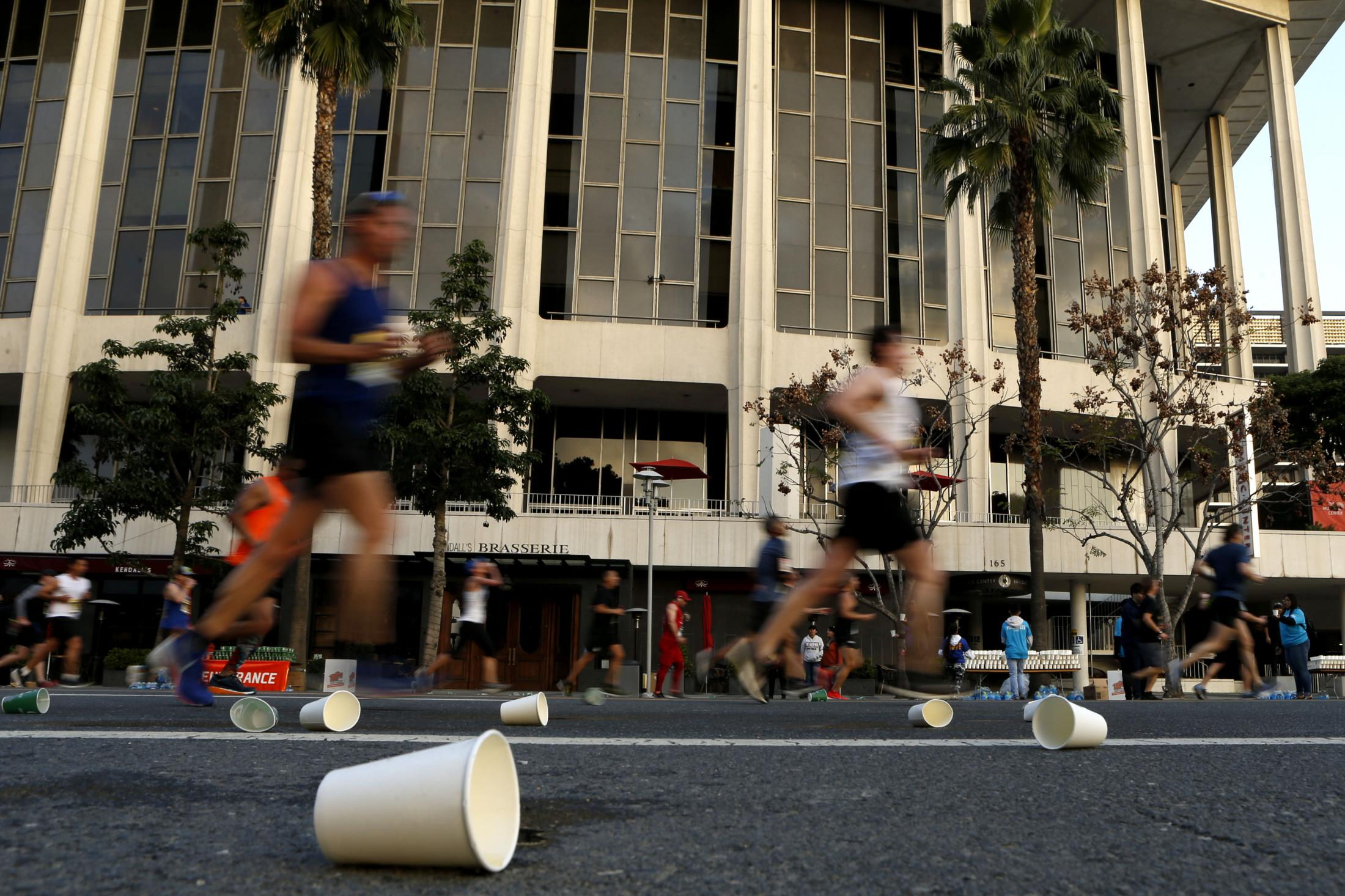 LOS ANGELES, CALIFORNIA - MARCH 24:   Runners run past the Dorothy Chandler Pavilion during the 2019 Skechers Performance Los Angeles Marathon on March 24, 2019 in Los Angeles, California. (Photo by Katharine Lotze/Getty Images)