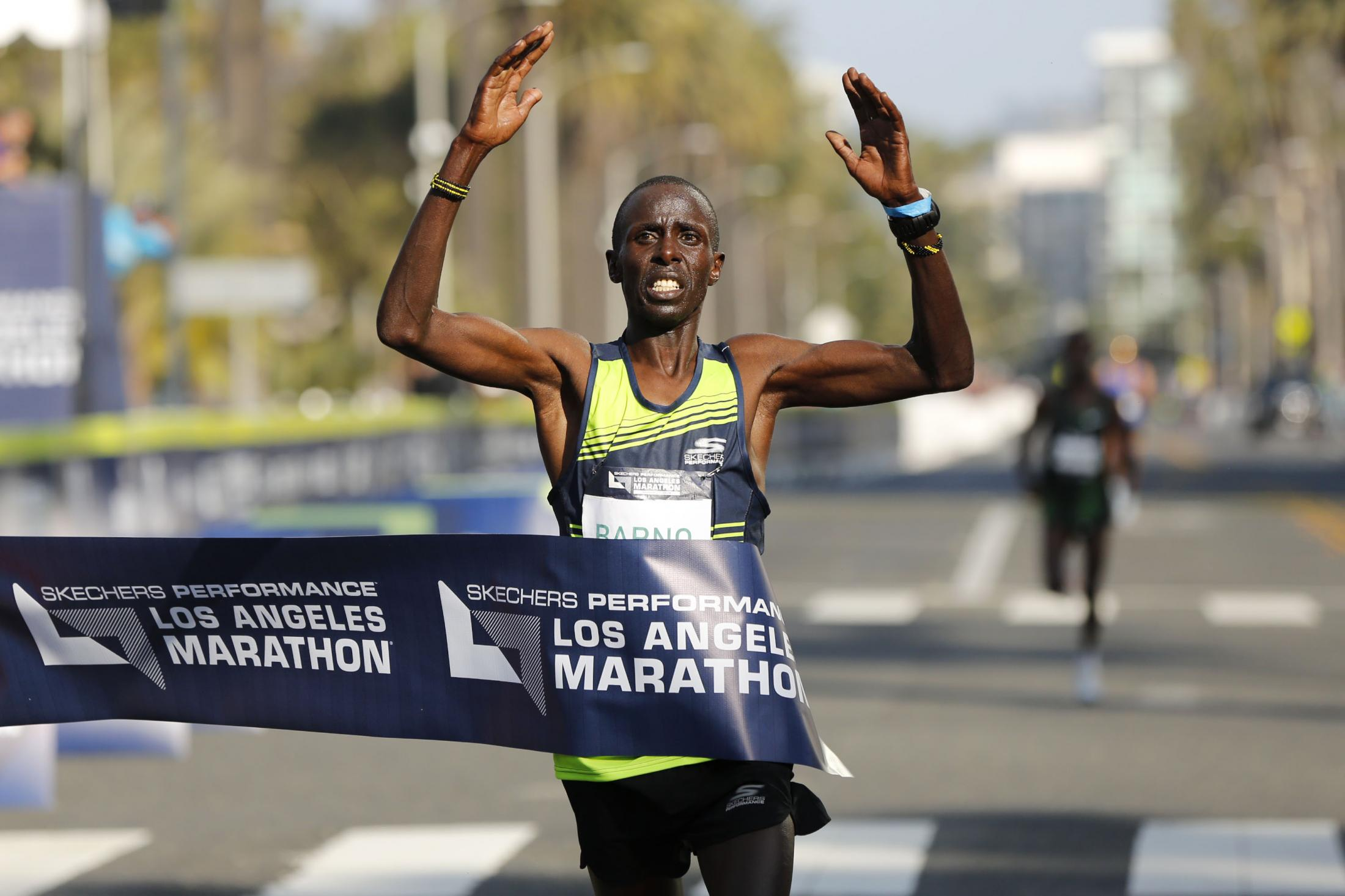 LOS ANGELES, CALIFORNIA - MARCH 24:  Elisha Barno of Kenya crosses the finish line to win the 2019 Skechers Performance Los Angeles Marathon in 2 hours, 11 minutes, 45 seconds on March 24, 2019 in Los Angeles, California. (Photo by Katharine Lotze/Getty Images)