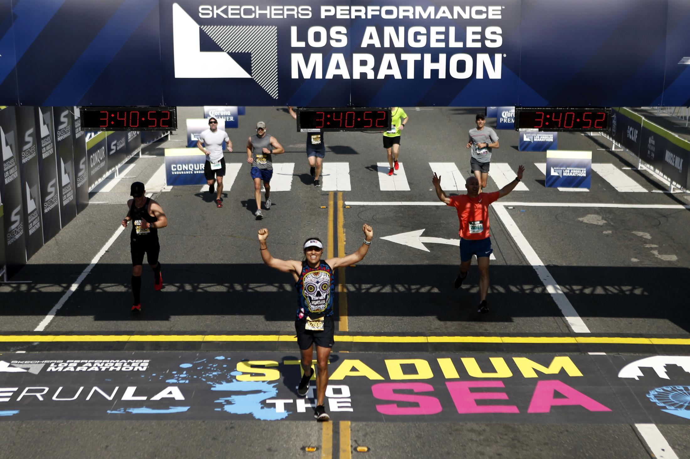 LOS ANGELES, CALIFORNIA - MARCH 24:  Jesus M. Rodriguez smiles as he crosses the finish line of the 2019 Skechers Performance Los Angeles Marathon on March 24, 2019 in Los Angeles, California. (Photo by Katharine Lotze/Getty Images)
