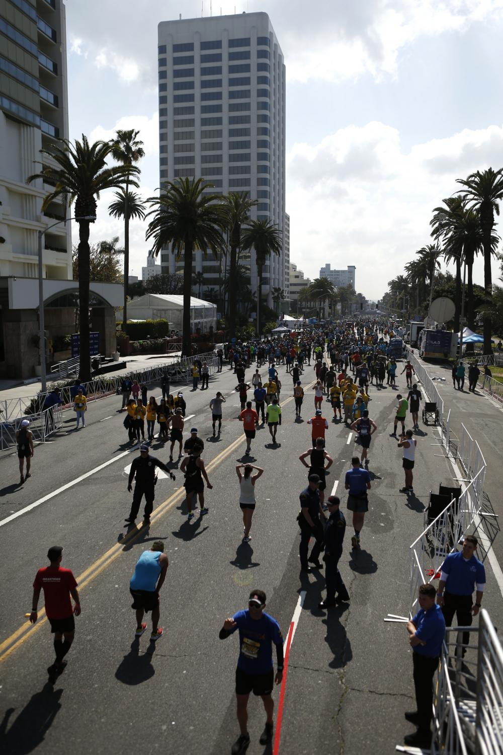 LOS ANGELES, CALIFORNIA - MARCH 24:  Runners walk after crossing the finish line of the 2019 Skechers Performance Los Angeles Marathon on March 24, 2019 in Los Angeles, California. (Photo by Katharine Lotze/Getty Images)