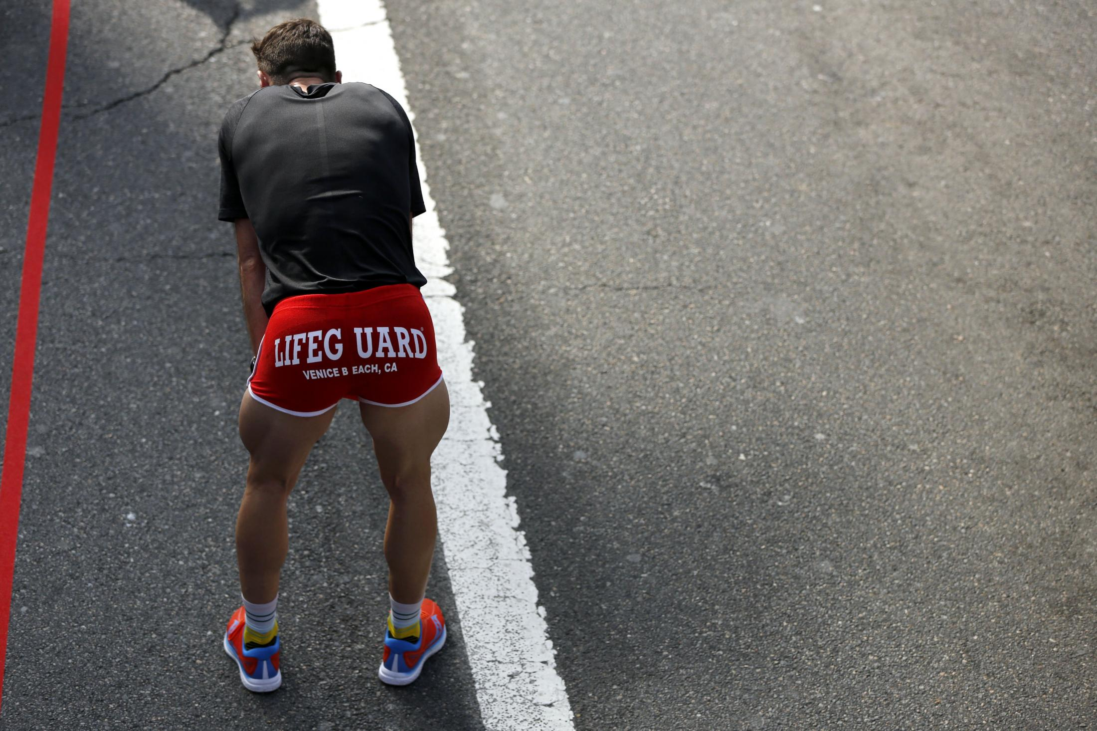 LOS ANGELES, CALIFORNIA - MARCH 24:  A runner rests after crossing the finish line of the 2019 Skechers Performance Los Angeles Marathon on March 24, 2019 in Los Angeles, California. (Photo by Katharine Lotze/Getty Images)