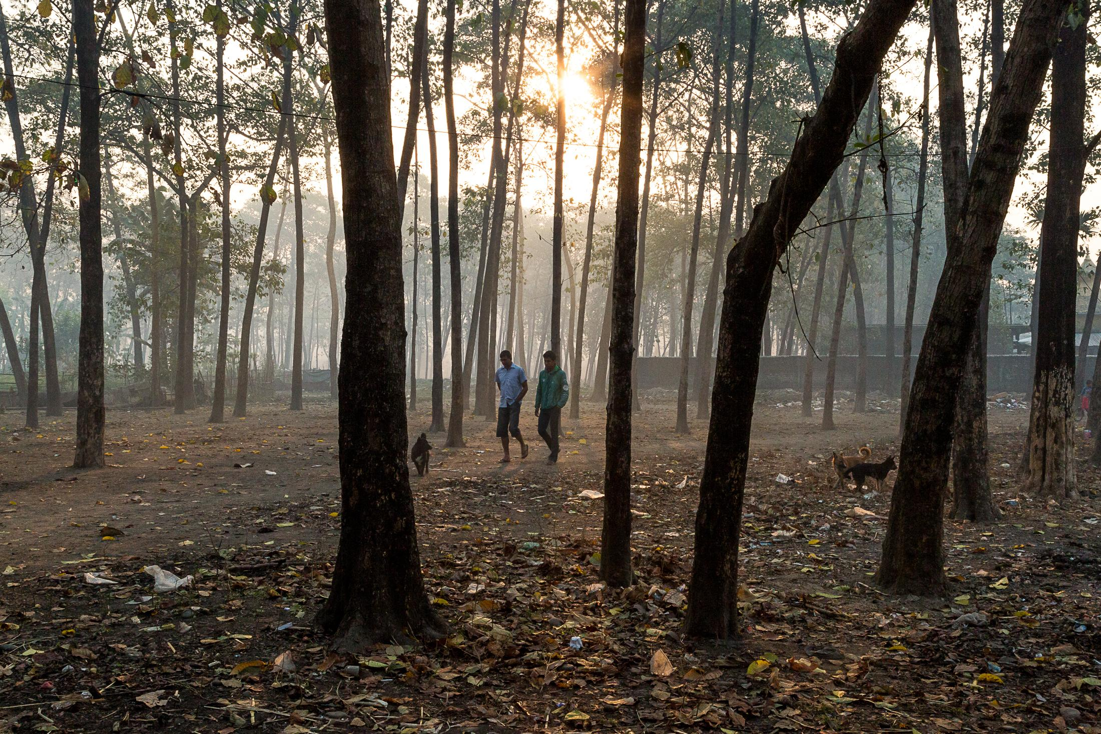 BELDANGI, NEPAL - MARCH 13: Two Bhutanese refugees walk early in the morning in the middle of the forests surrounding the Beldangi 2 refugee camp on March 13, 2015 in Beldangi, Nepal. Photo: © Omar Havana / Getty Images.