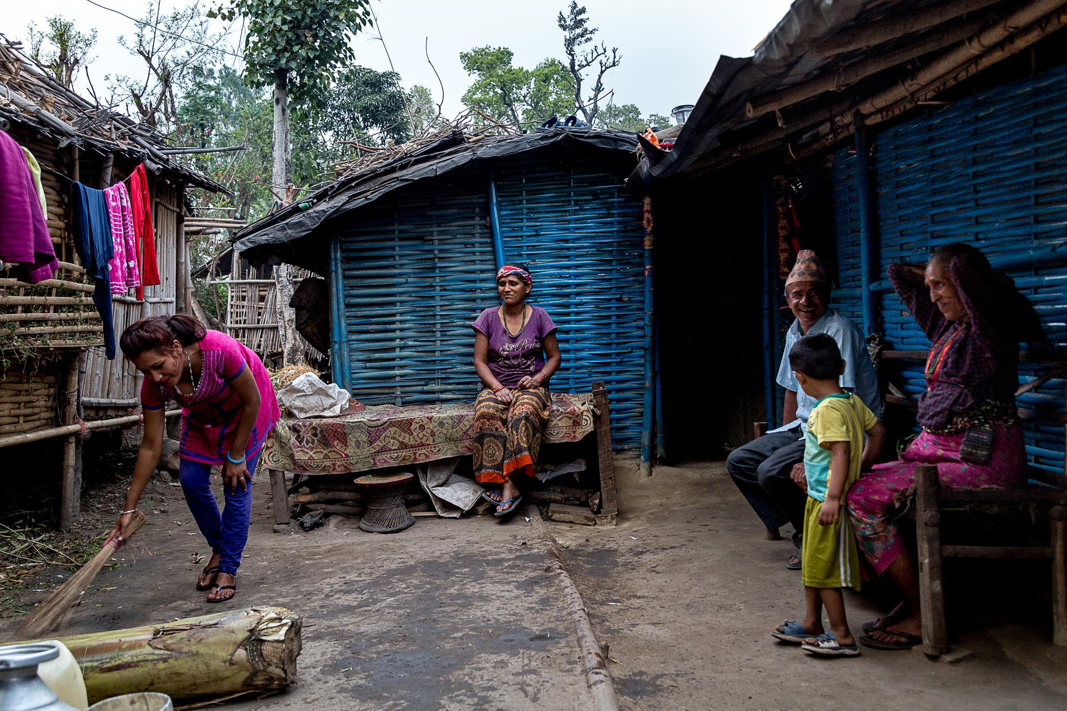 BELDANGI, NEPAL - MARCH 14: Refugees chat in front of their houses inside the Beldangi 2 refugee camp on March 14, 2015 in Beldangi, Nepal. Photo: © Omar Havana.