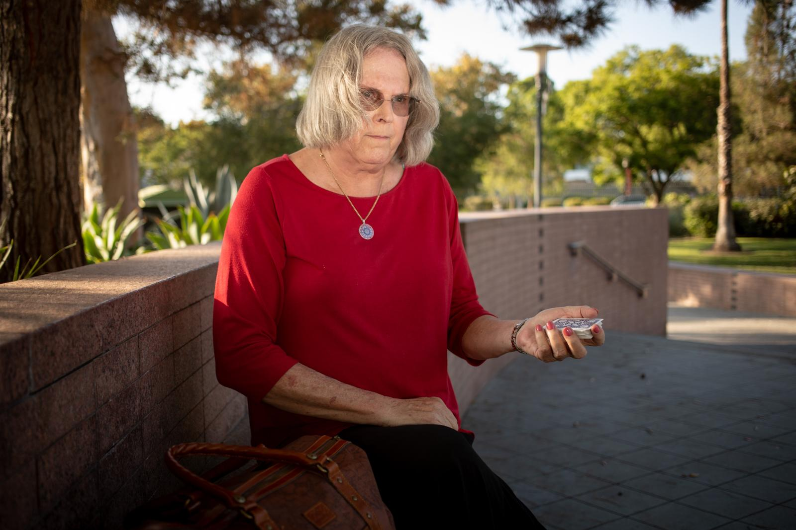 Malinda Lodge, 68, performs a card trick at the La Brea TarPits in Los Angeles.