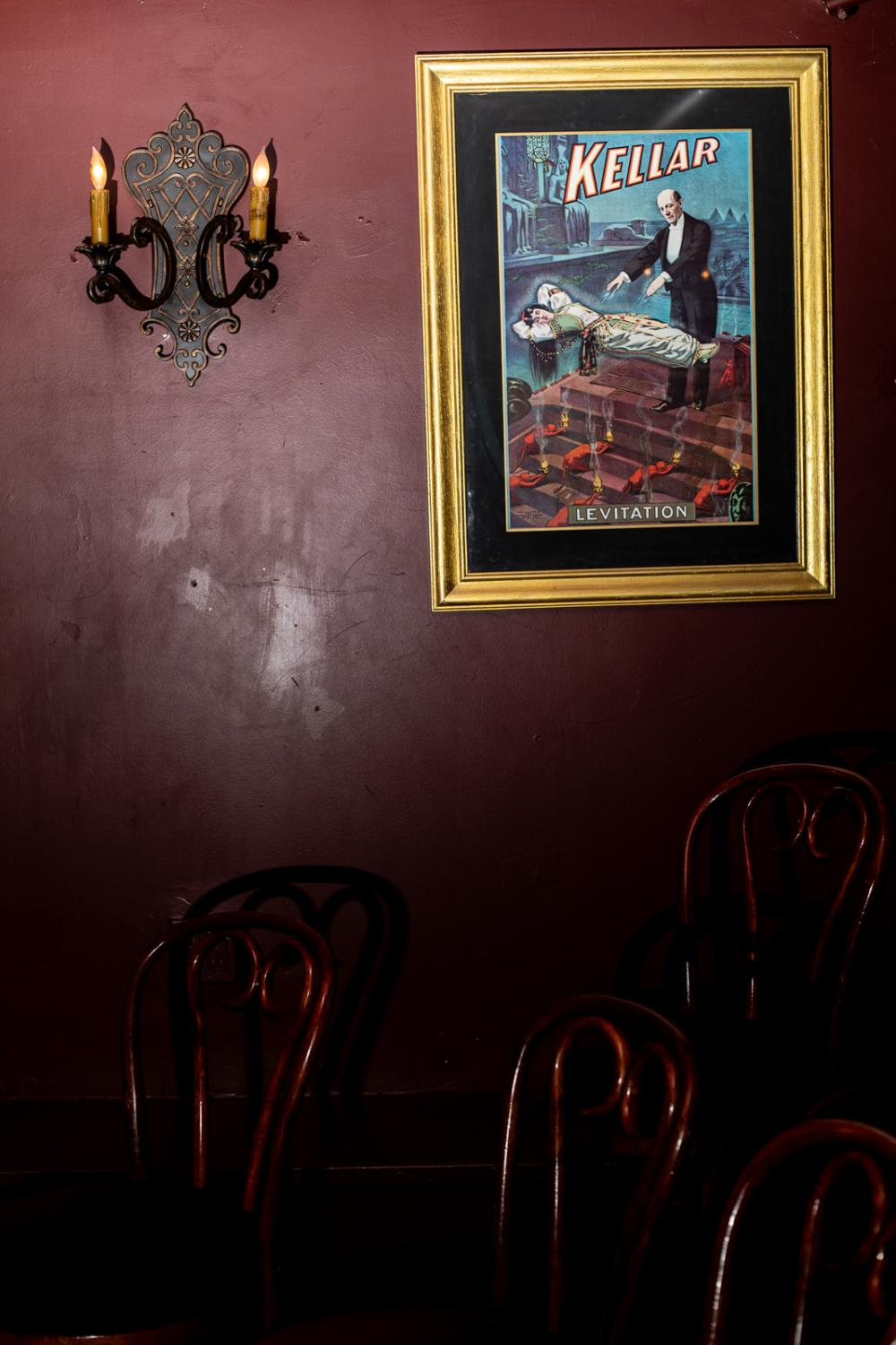 A poster of a levitation trick performed by the famous magician Harry Kellar and his female assistant hangs on the wall of the Magic Castle in Los Angeles.