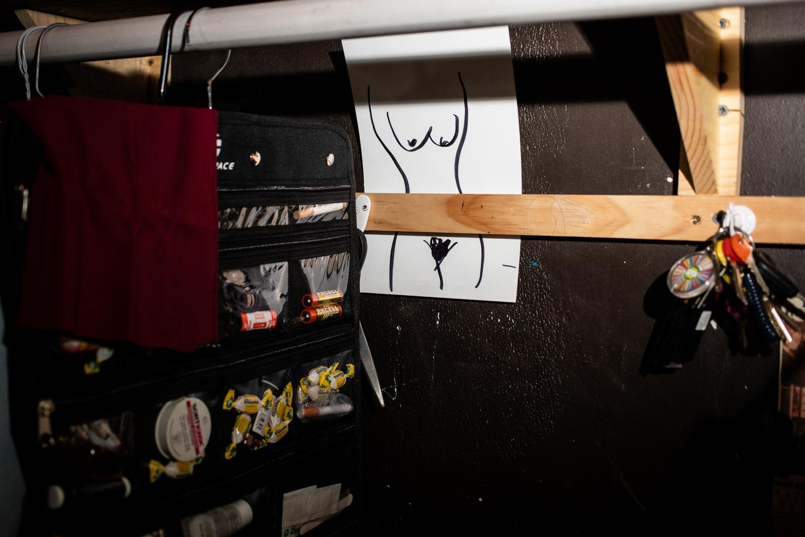 A drawing and some magic props inside a dressing room at the Black Rabbit Rose, a magic club in Hollywood.