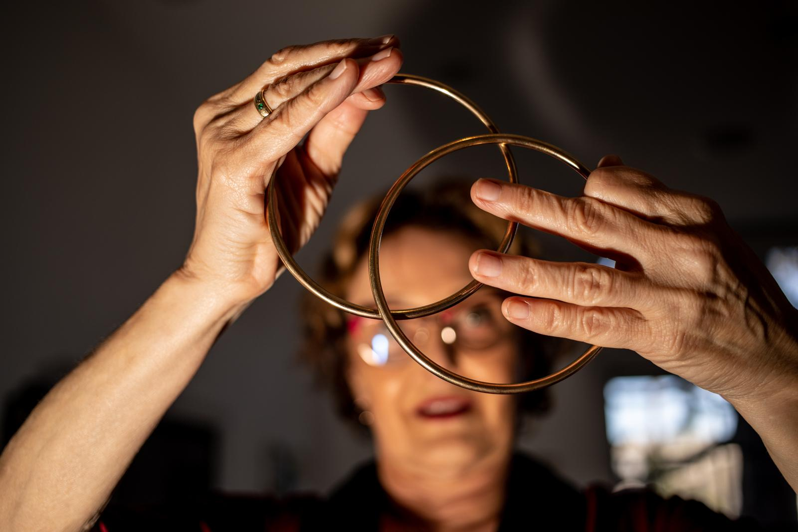 Patricia Marquis practices a trick with Chinese linking rings in her apartment in Beverly Hills.