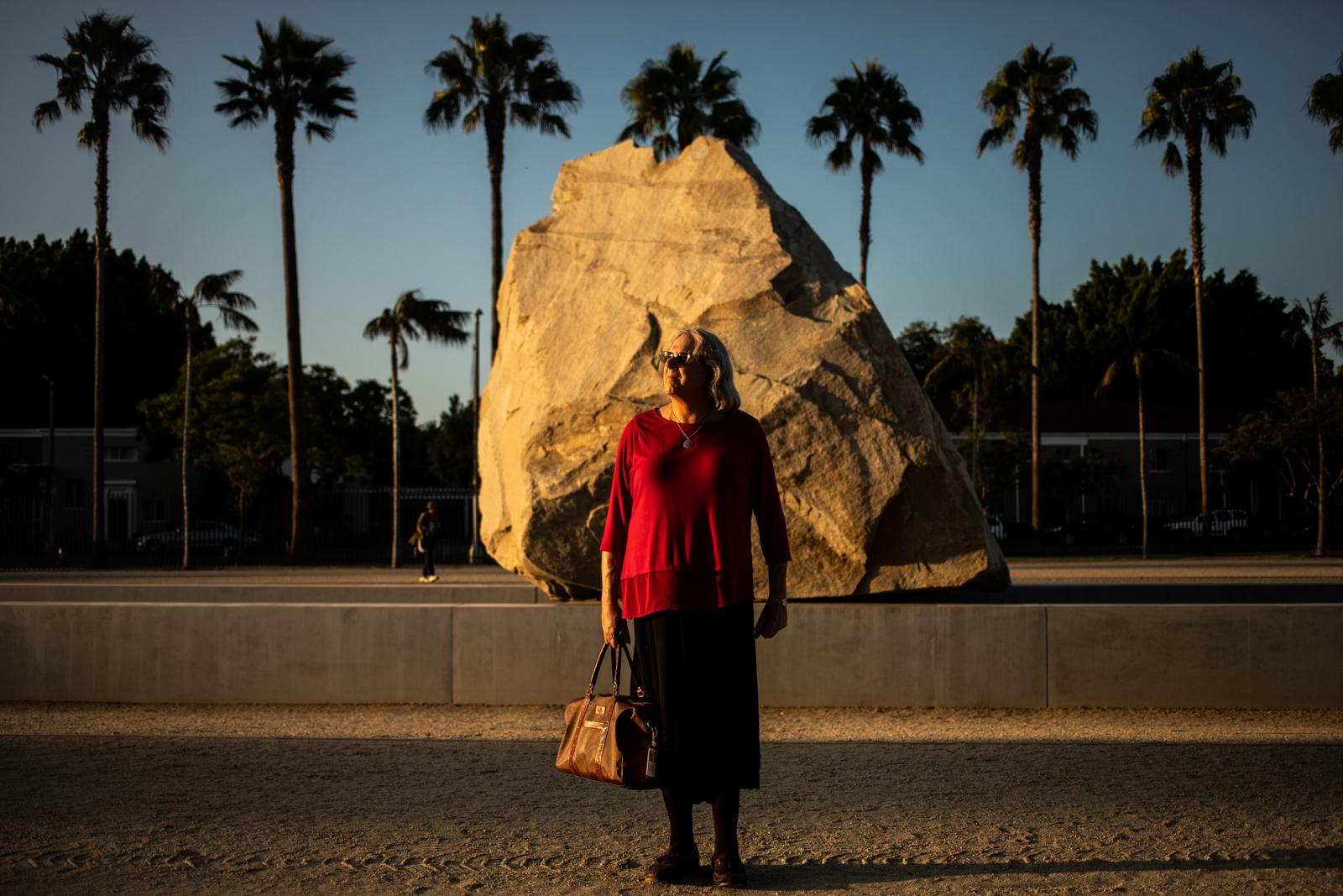 Malinda Lodge, 68, stands for a portrait while holding her magic bag outside the LACMA in Los Angeles. Malinda became a member of the Magic Castle in 1974 and a professional magician in 1989.