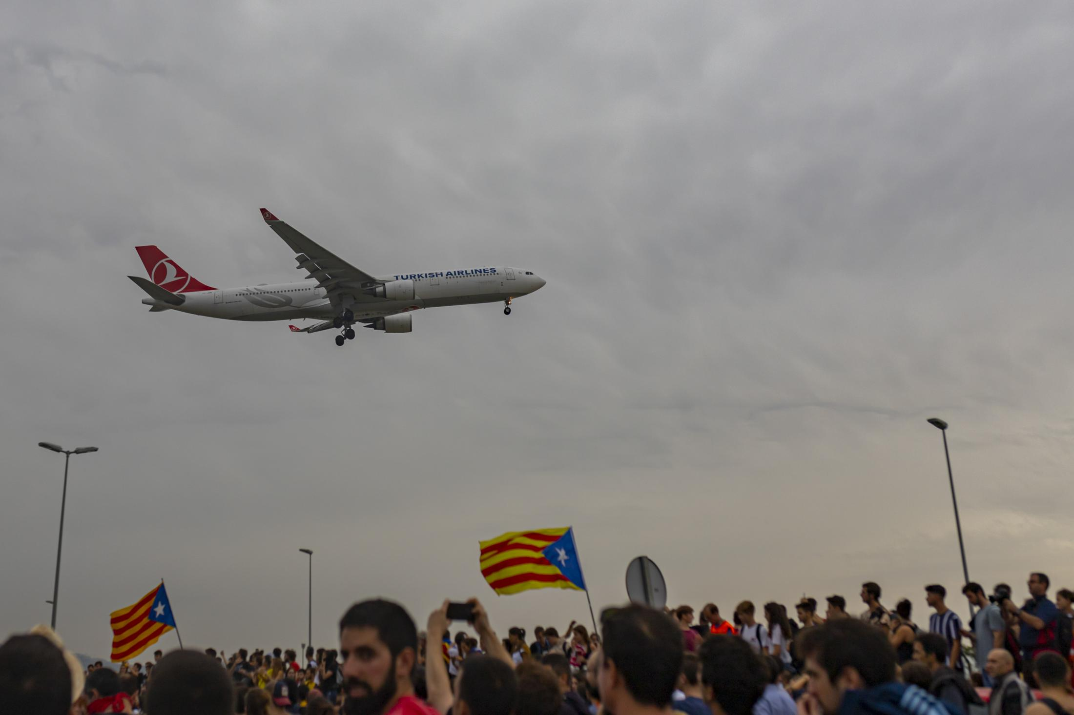 Tsunami Democratic collapses Barcelona. Catalan separatist leaders given lengthy prison sentences. The demonstrations in El Prat airport were organized by Tsunami Democratic, an organization that claims to be an independent grassroots movement, without any political back-up. Thousands of people responded, heading to the airport by cars, trains, metro and even on foot. More than 100 flights were canceled, and several others were delayed as activists clashed with police. October 2019, Barcelona, Spain.