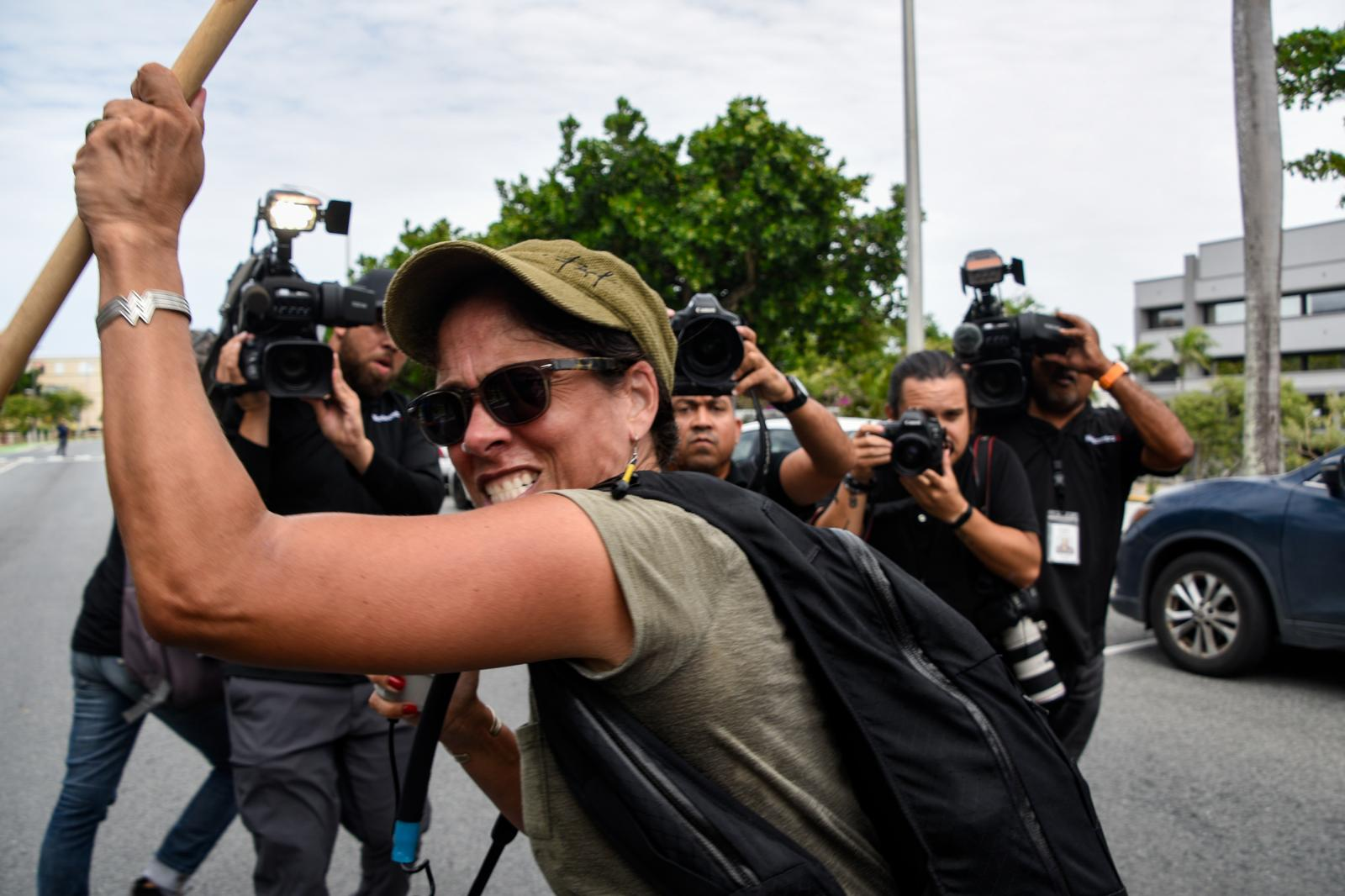 A lone protester tries to stop the car of Pedro Pierluisi, a politician from the statehood party that took over the governance of the island following Rosselló but was later considered as unconstitutional by the Supreme Court and was asked to step down.