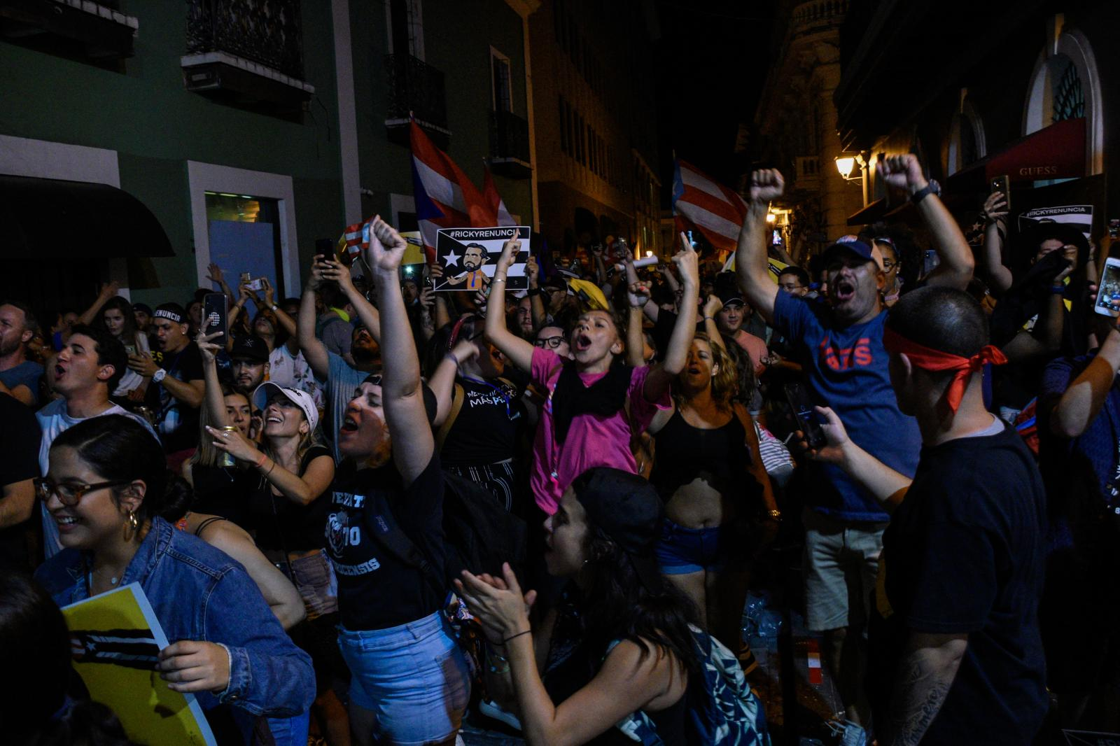 Demonstrators celebrate the resignation of Ricardo Rosselló after a marathon of protests during the course of summer 2019.