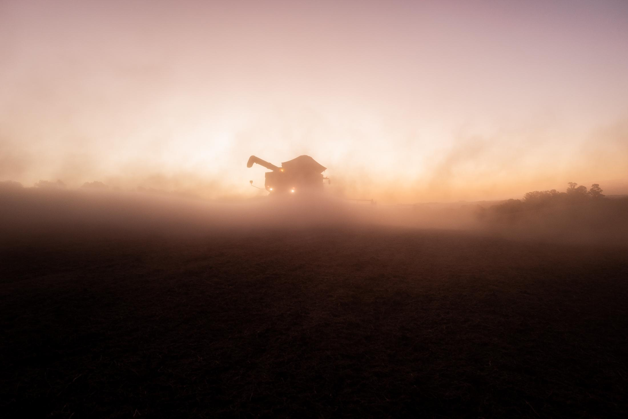 """Combine harvester in soybean fields in southern Brazil. Soy is the """"green gold"""" of Brazil."""