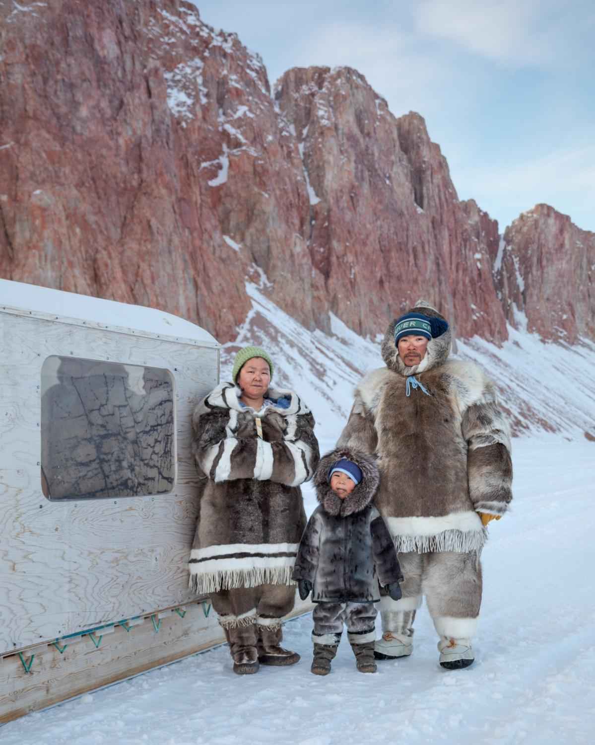 Winter clothing made from caribou skin keeps Valerie and Michael Qaunaq warm, while their three-year-old son, Joshua, stays bundled up in an outfit made from a harp seal.