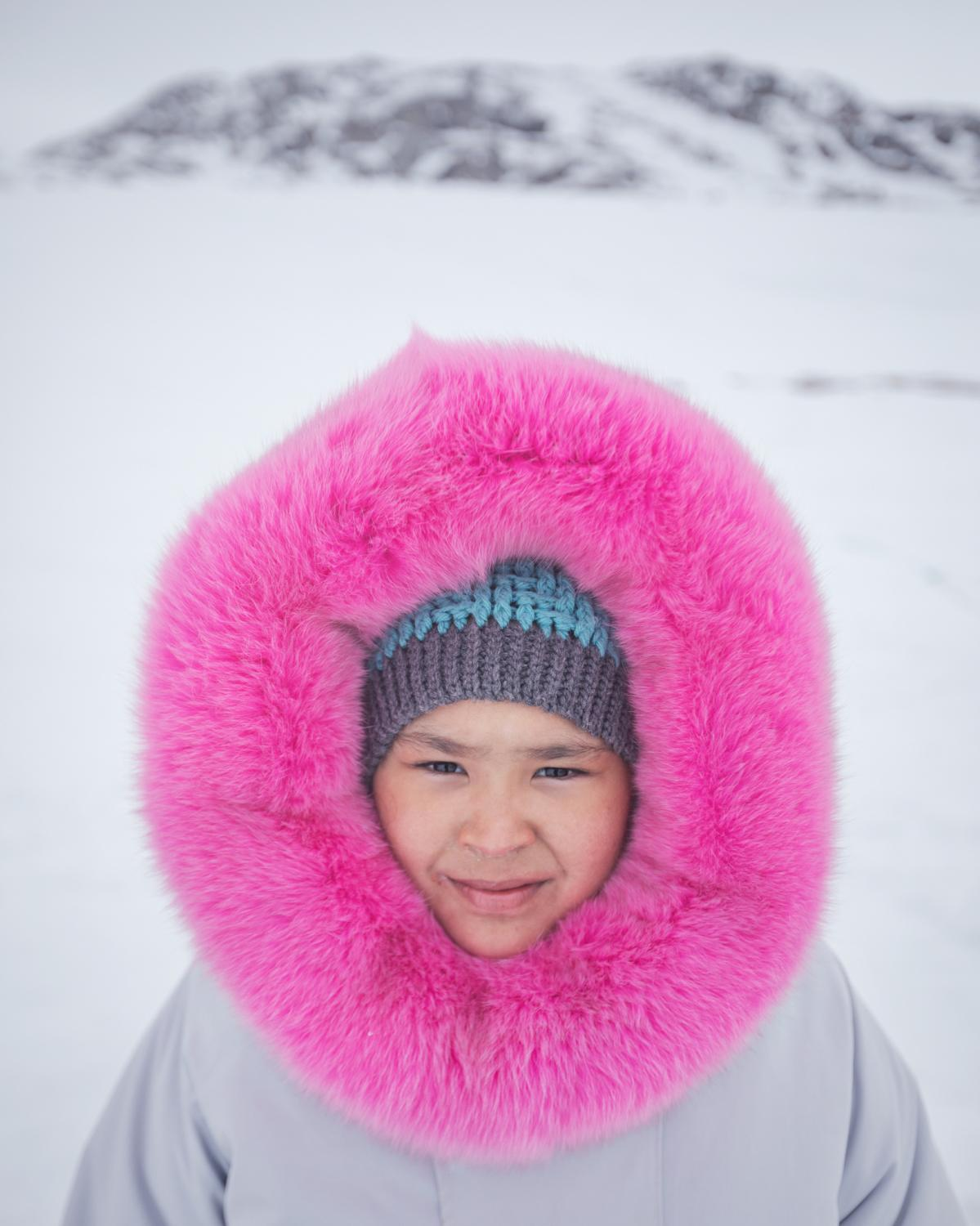 Wearing a parka sewn by her mother, Ashley Hughes spent her 10th birthday camping with friends and family at Ikpikittuarjuk Bay. Hughes took part in the Inuit community's annual ice fishing competition for arctic char.
