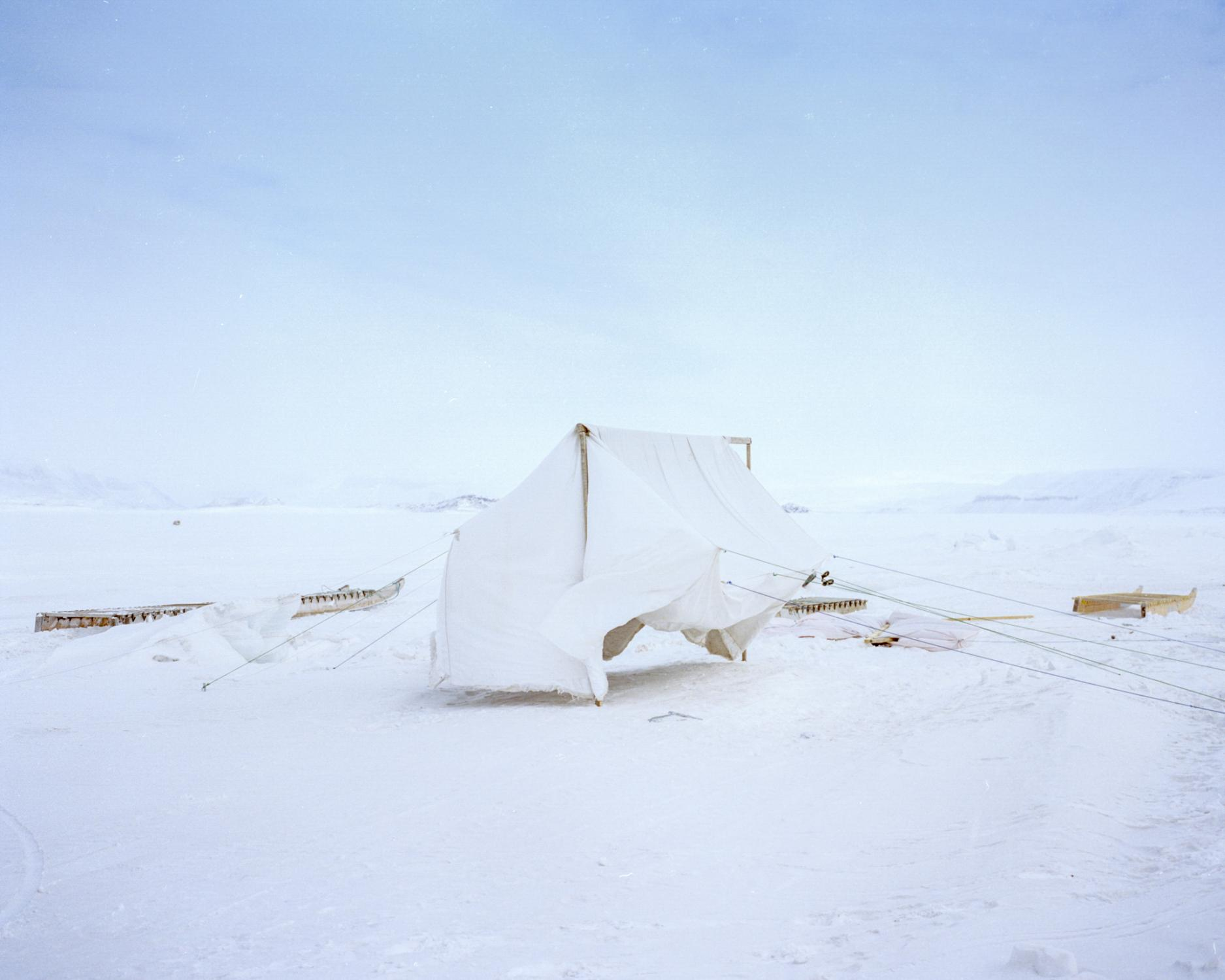 Before a camping trip, a homemade tent dries on the sea ice in Arctic Bay, Nunavut.