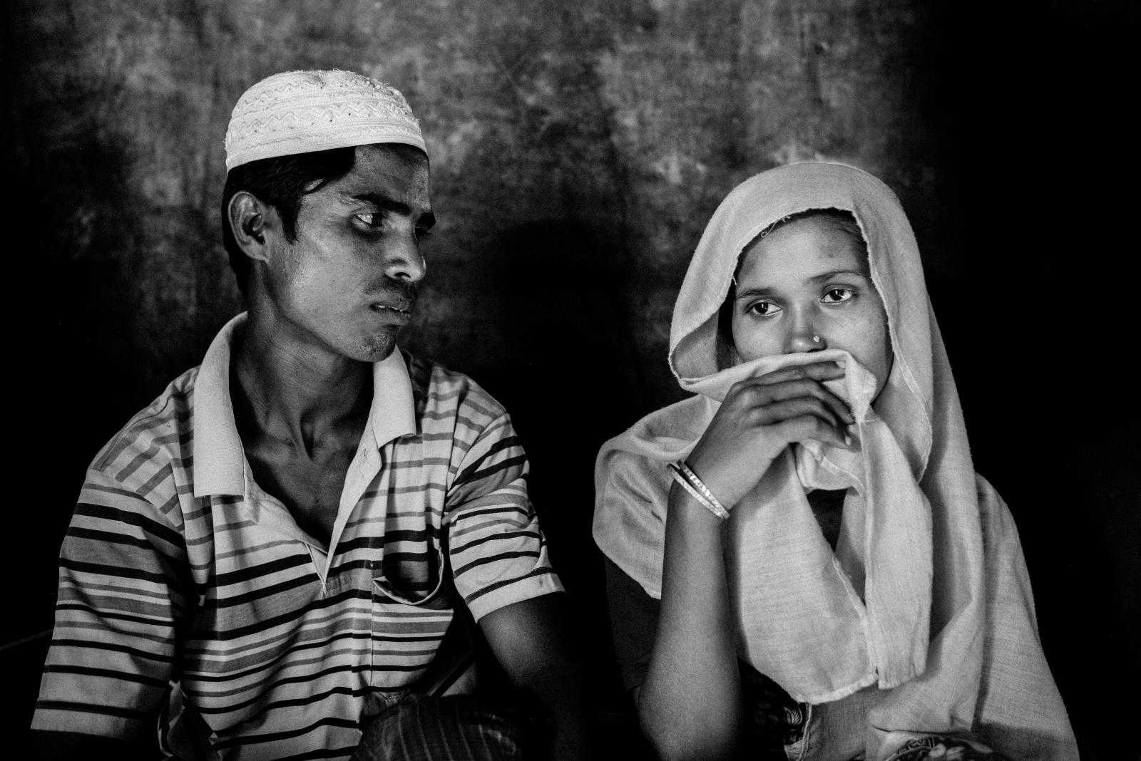 Mohammed Hossain, 25, and Rashida Begum, 23, husband and wife from Tula Toli village.  The village of Tula Toli was burnt to the ground with men being killed and dumped in a mass grave and many women subjected to sexual violence.  Rashida was raped by Myanmar soldiers and also suffered having her throat sliced open.