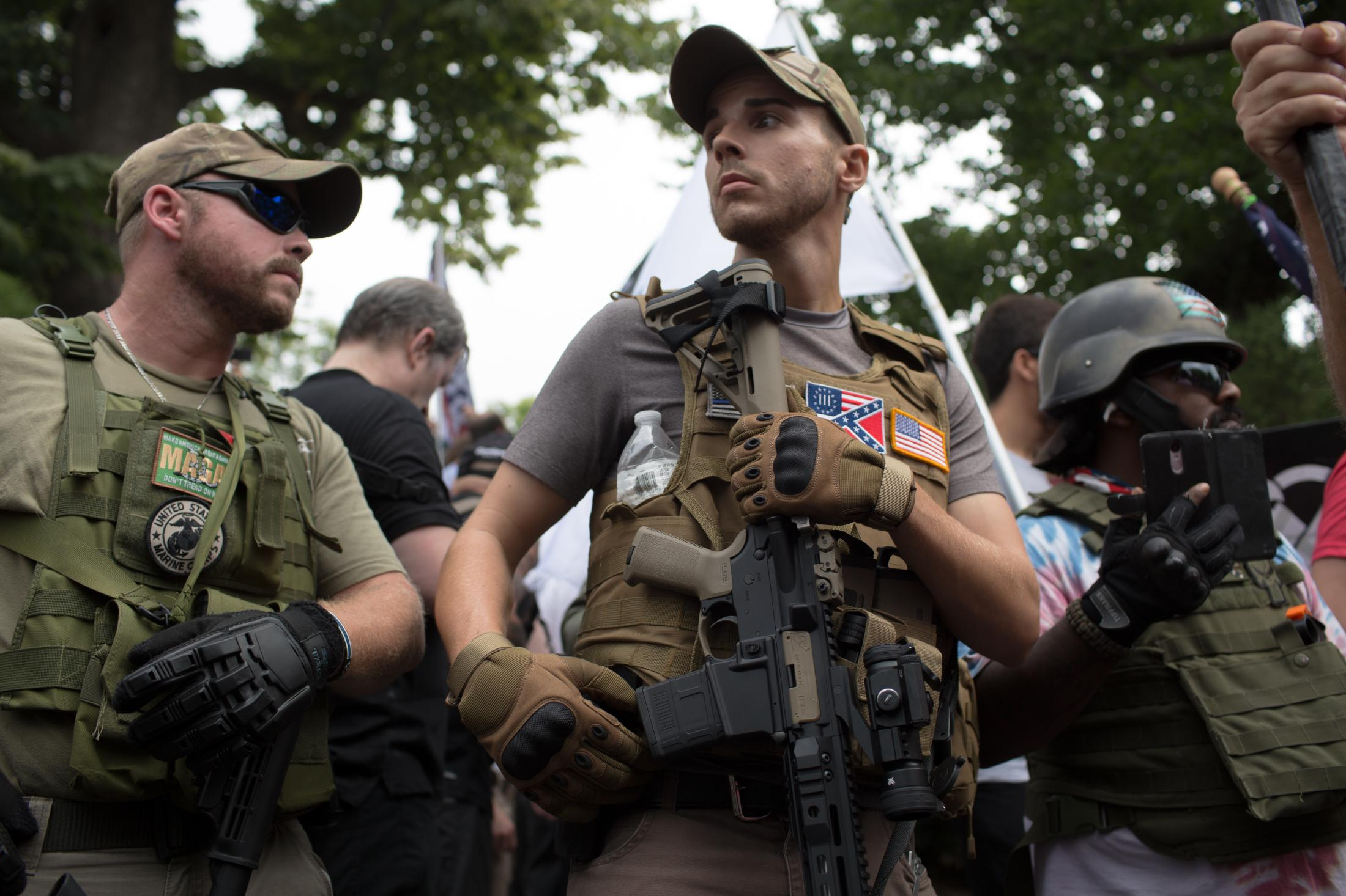 Militia members stand guard around Emancipation Park in Charlottesville, VA as protesters make their way into Emancipation Park for the Unite the Right rally on August 12, 2017.